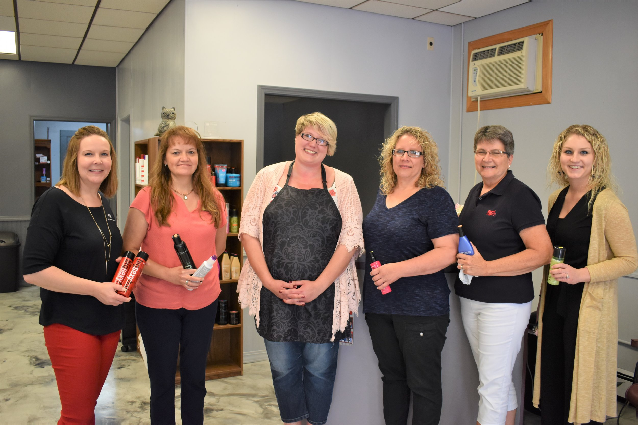 Some of Royal Banks 'Cash Mob' participants L to R- Heather Mobley, Jill Eischenk, Guys and Gals owner Tricia Johnson, Kari Van Hecker, Bev Downing, and Shania Landsinger
