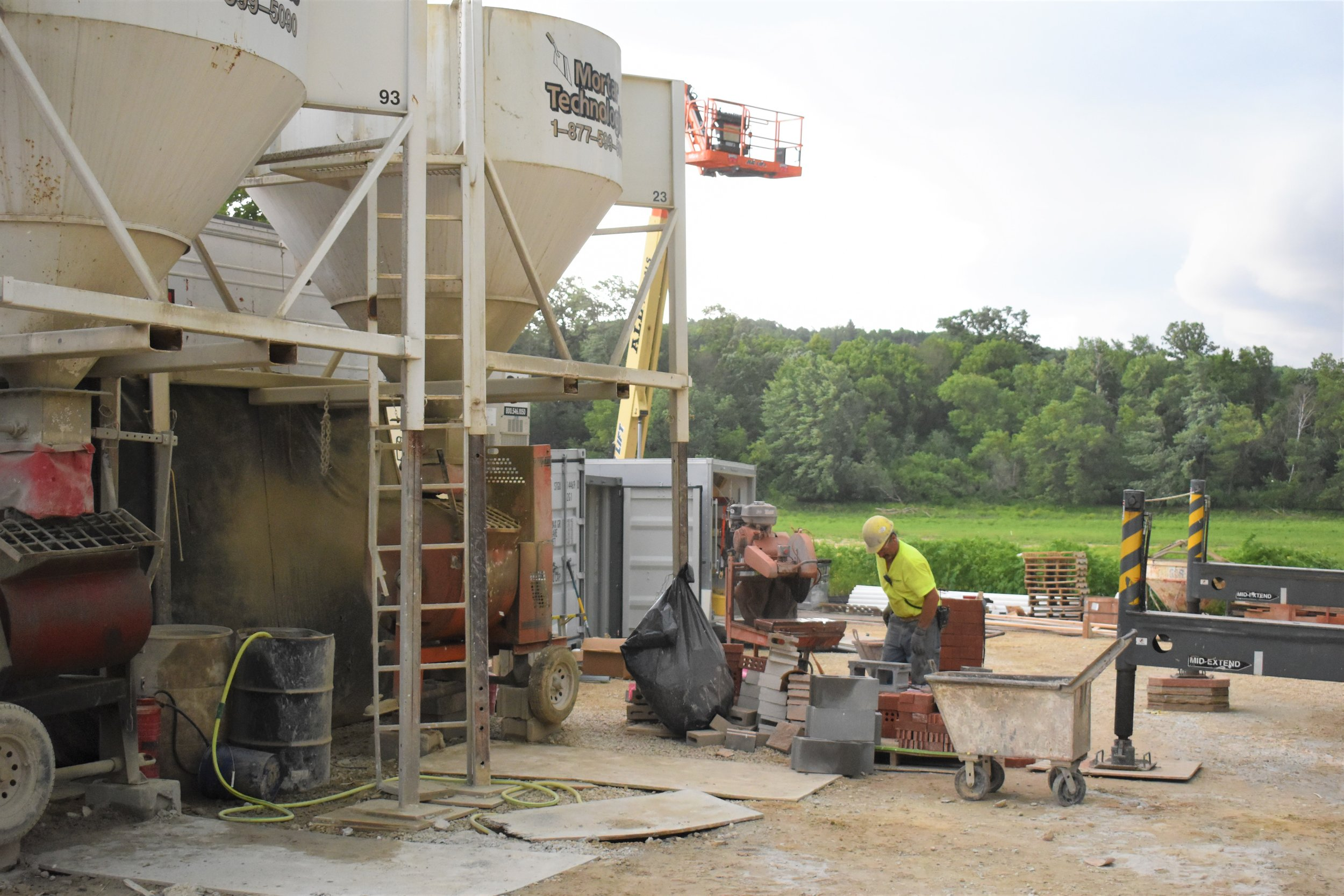 Workers mixing cement
