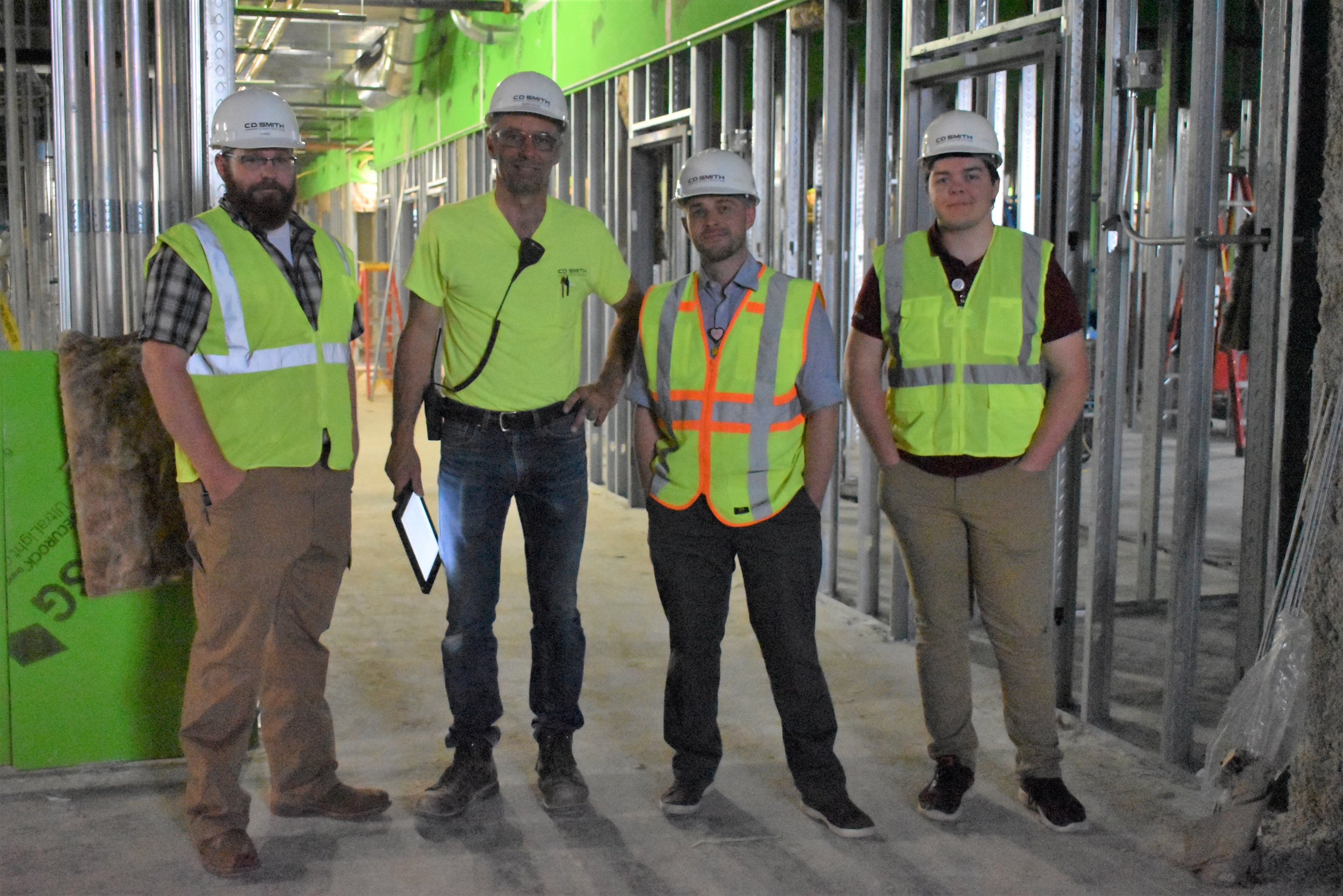 Pictured L to R, Director of Facility Operations-Aaron Hammer, CD Smith Construction Company Site Superintendent-Wayne Holum, Director of Marketing & Public Relations- Dan Howard and his summer inter- Jacob Bennish.