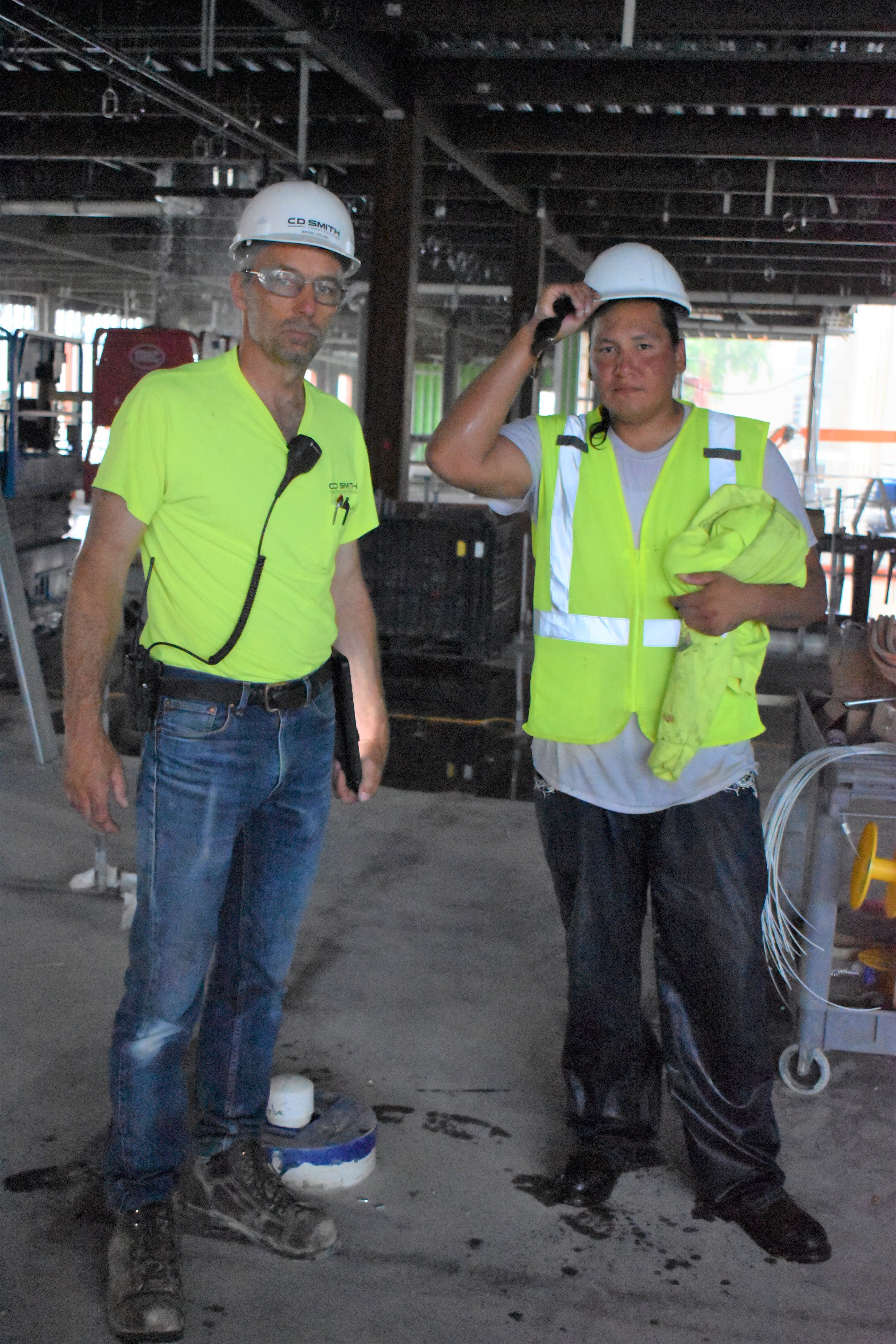 Site Superintendent Holum with roofer Mr. Cooper
