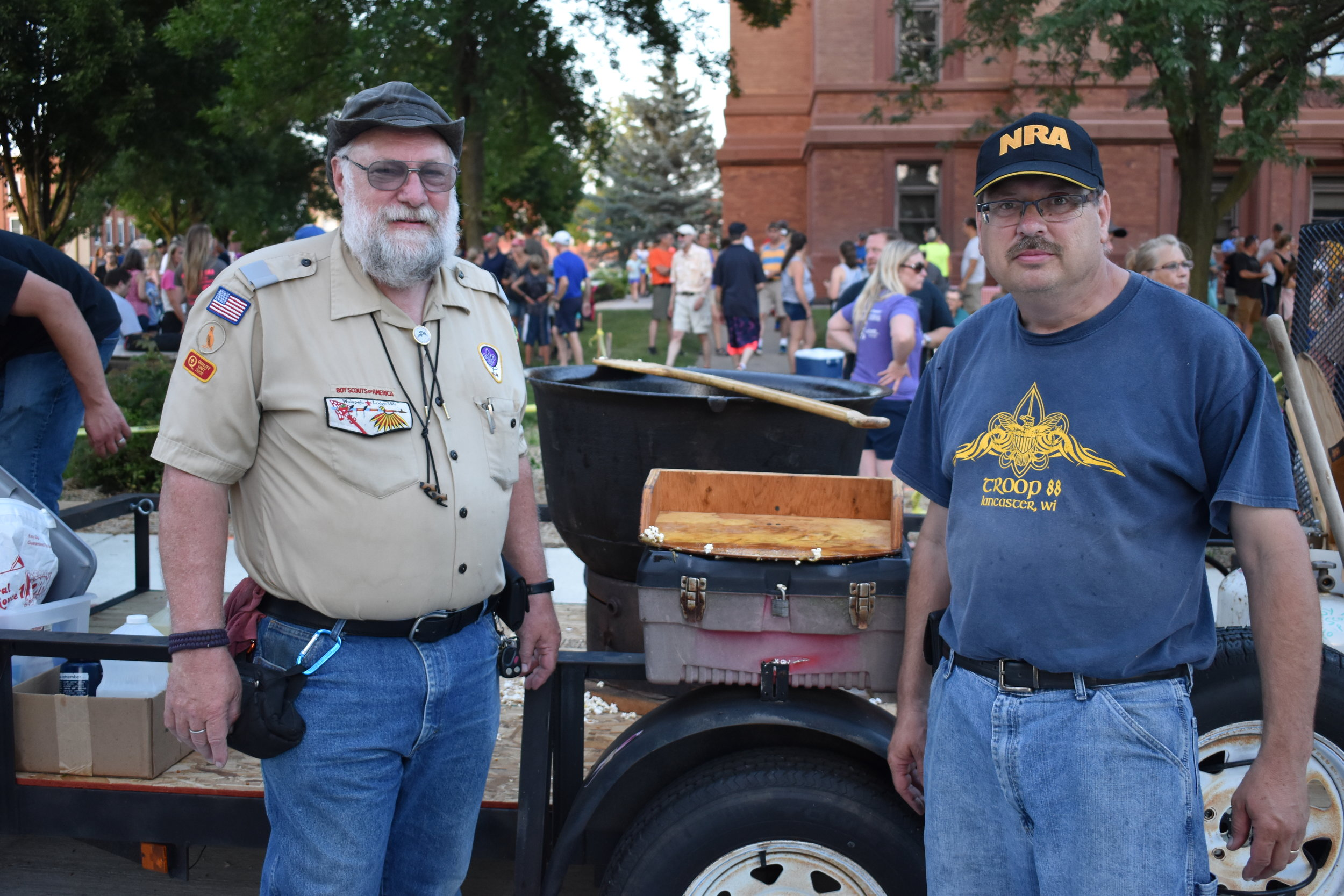 Mike Johansen Committee Chair and Scout Master Bill Lolwing of Lancaster's Boy Scouts Troop 88 popping kettle corn