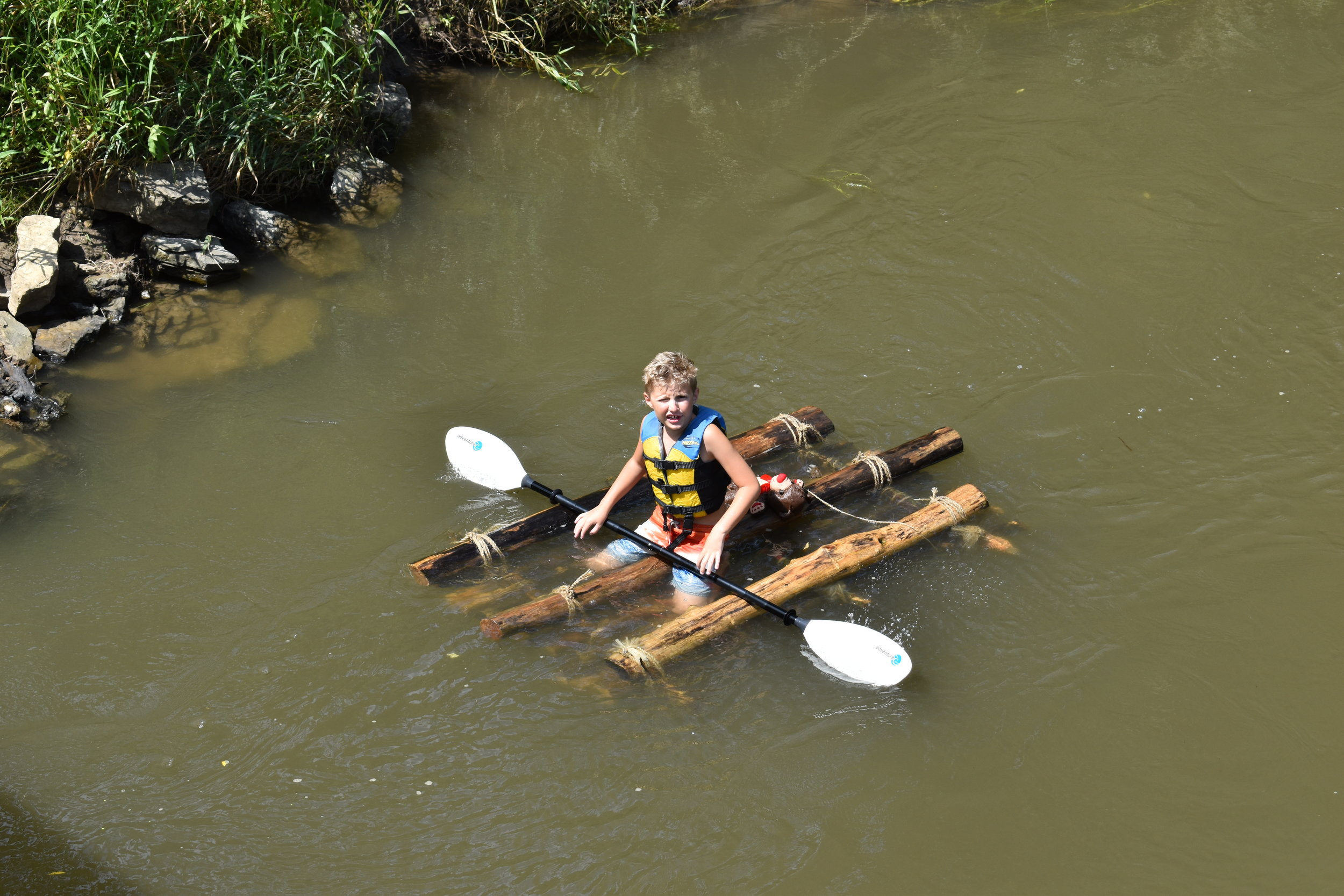 Hixson Katz finishing in first place, his brother not far behind in a canoe