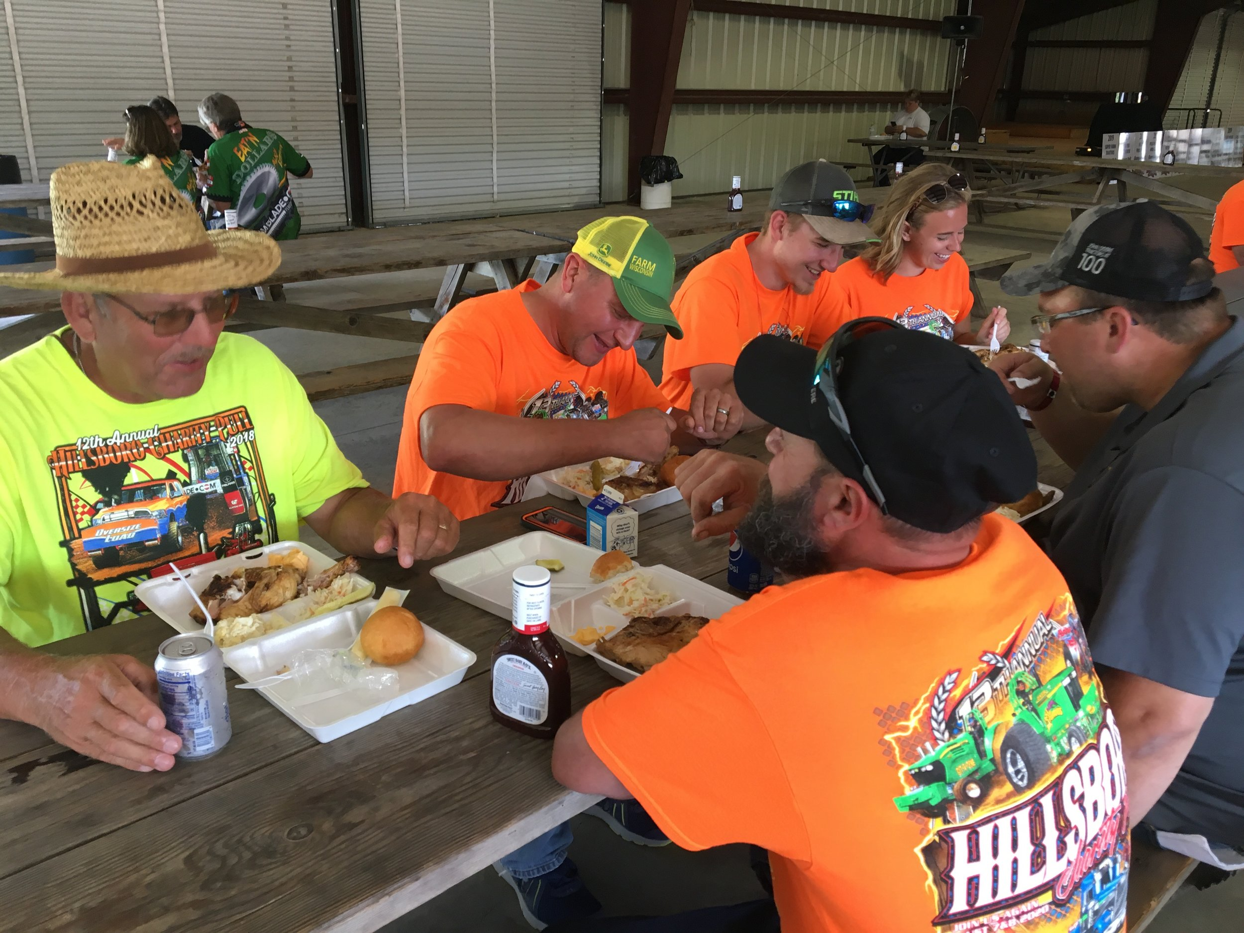 A few of the many volunteers from Hillsboro Equipment, Inc. chowing down