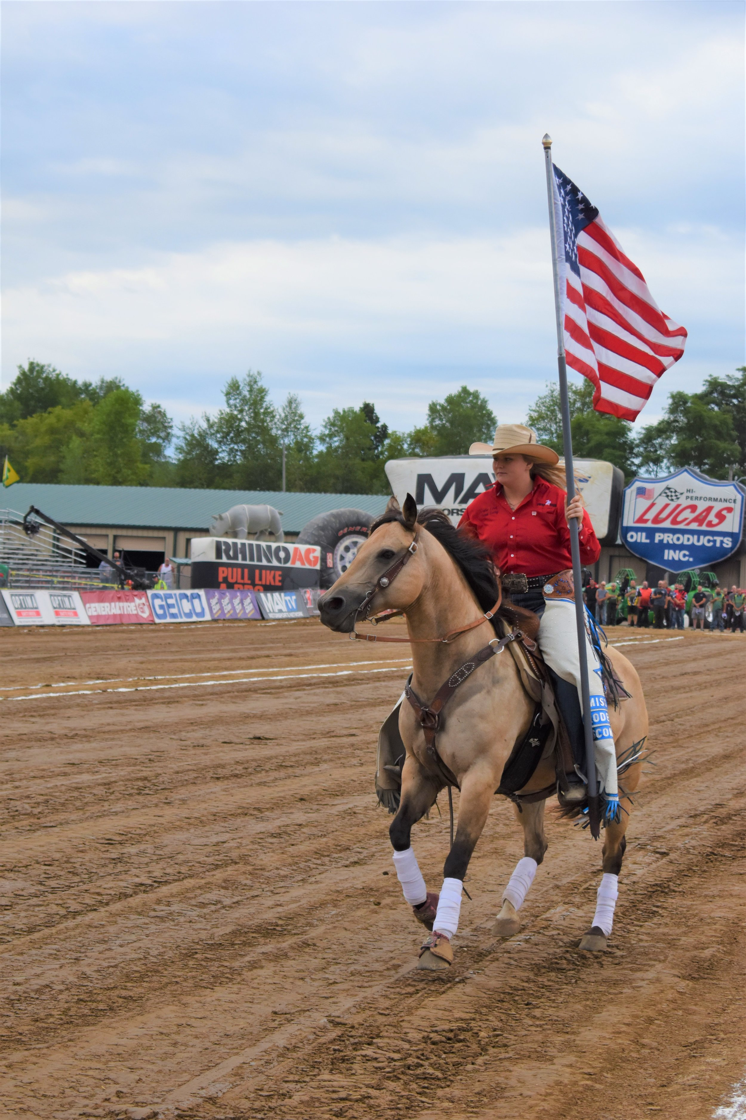 Jaycie Lind carries in the United States Flag riding her horse Snickers