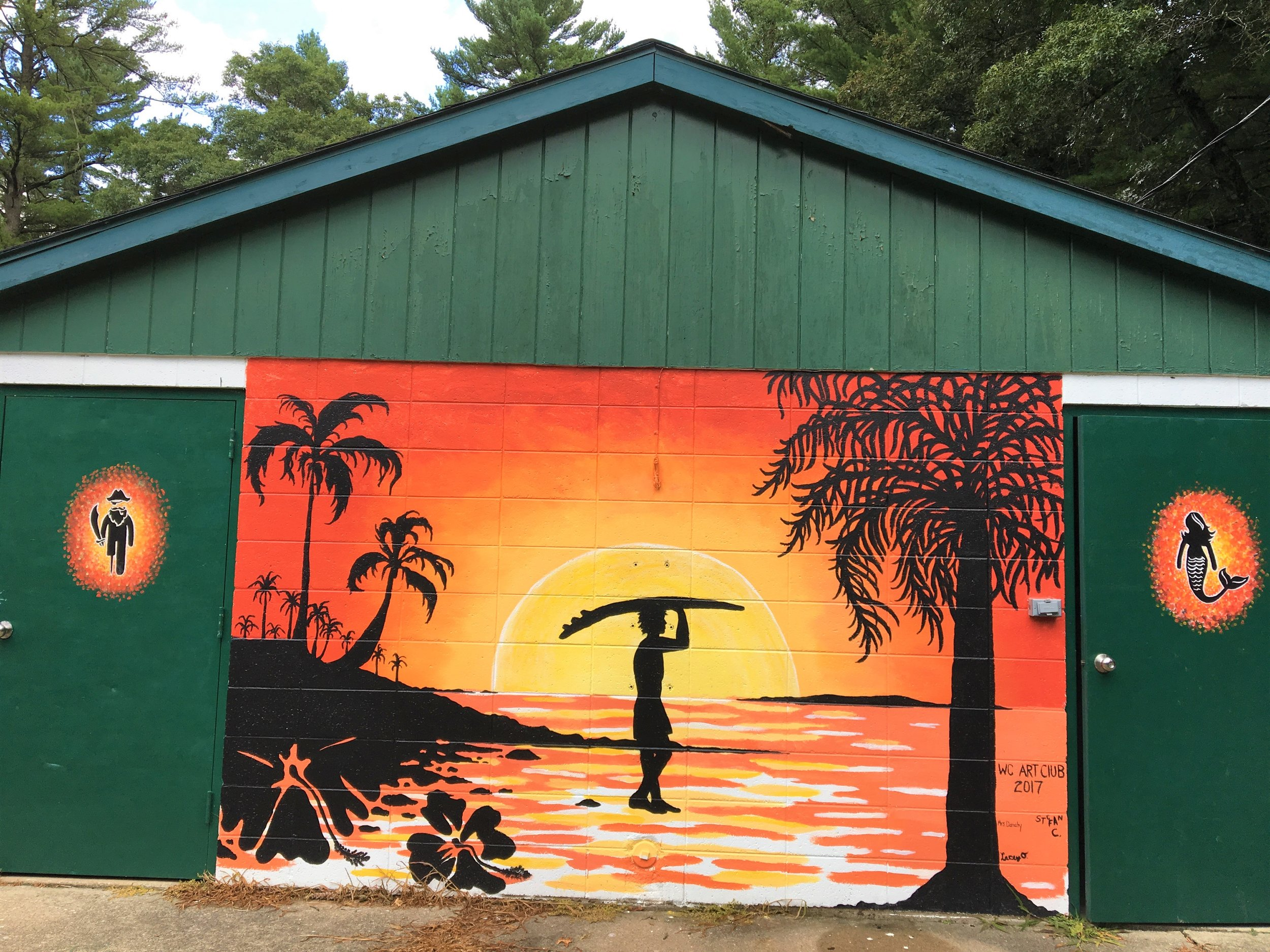 This beach scene painting at the Wonewoc swimming pool impressed Bill Huebel , leading him to contact its creator, art teacher Megan Danahy at Wonewoc-Center Schools.
