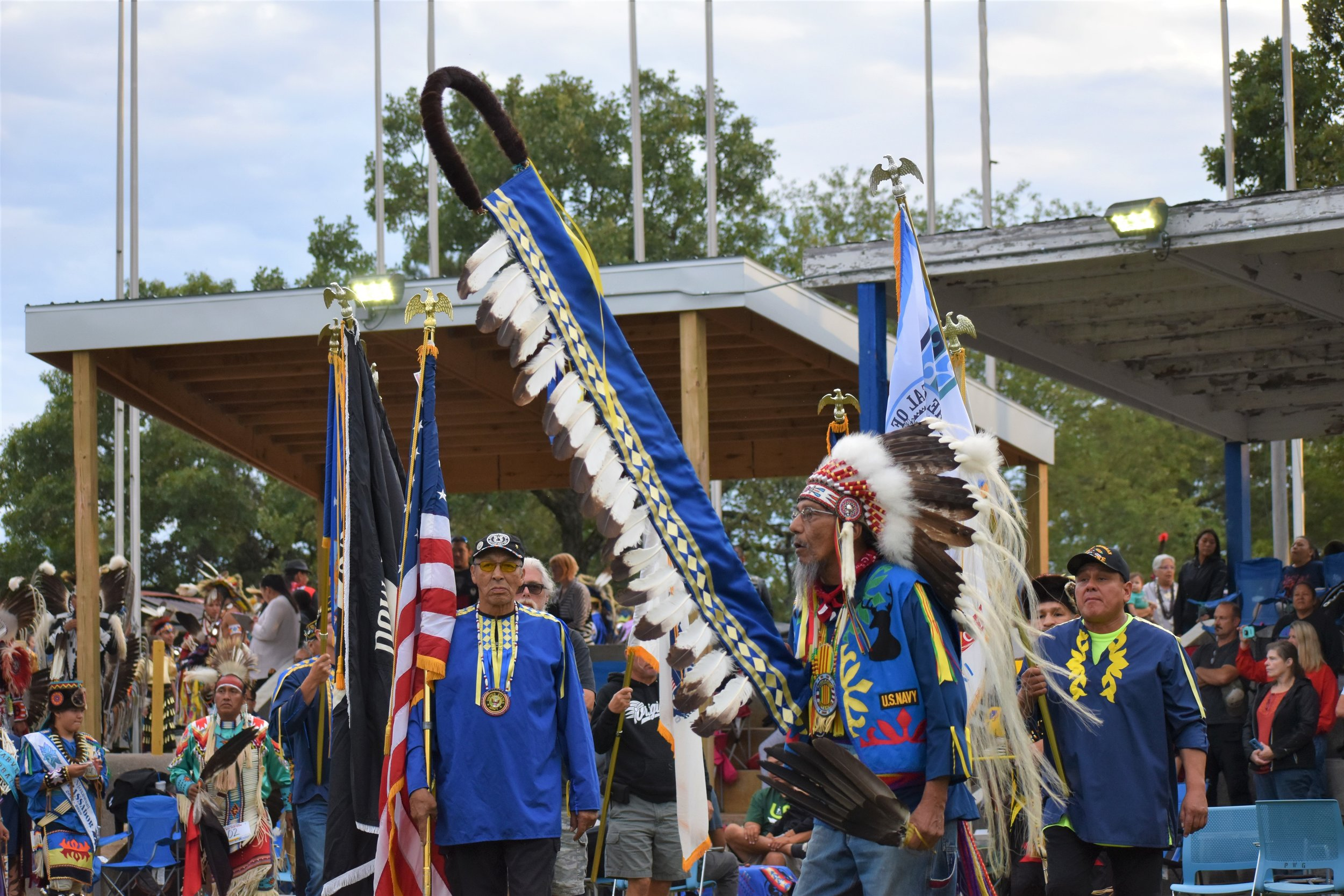 Vietnam Veteran, Mr. Levi Blackdeer carrying in the Ho-Chunk Eagle staff