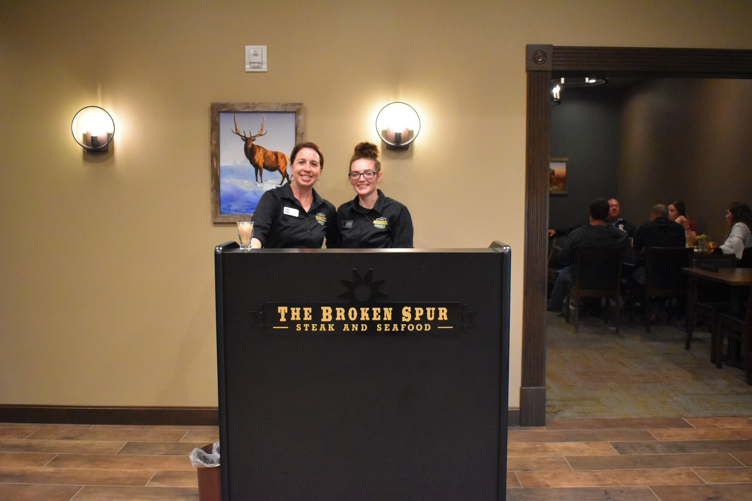 L to R- Front desk attendant and Two Elks event center co-coordinator Karen Boyle, and Broken Spur server Faith Ploof.