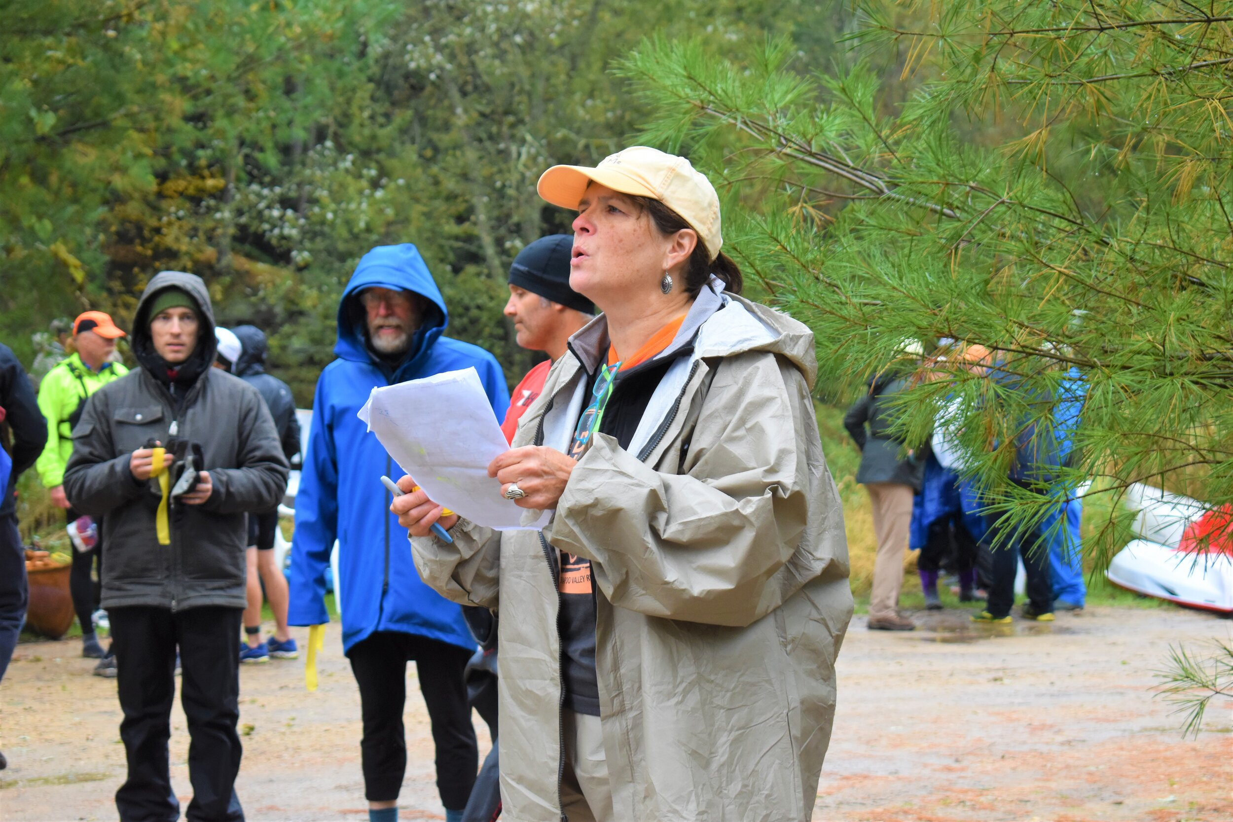 Volunteer Mary Lynn Dombroski reading the race rules and cautions to the competitors.