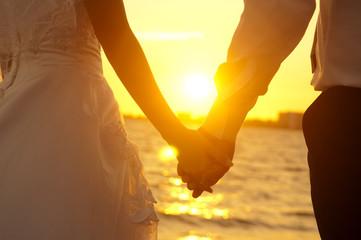 marriagehandsinsunset-1.jpg