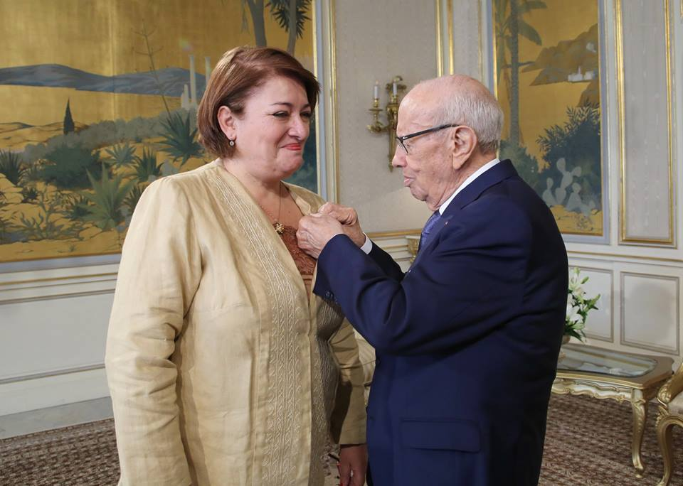 AIM member Iqbal Gharbi, a professor at the world reknown Université la Zitouna, receives a medal from President Essebsi of Tunisia for her contribution to the COLIBE Committee which recommended reformation for equal inheritance for women and men, for the abolishment of capital punishment, and for the decriminalization of homosexuality.
