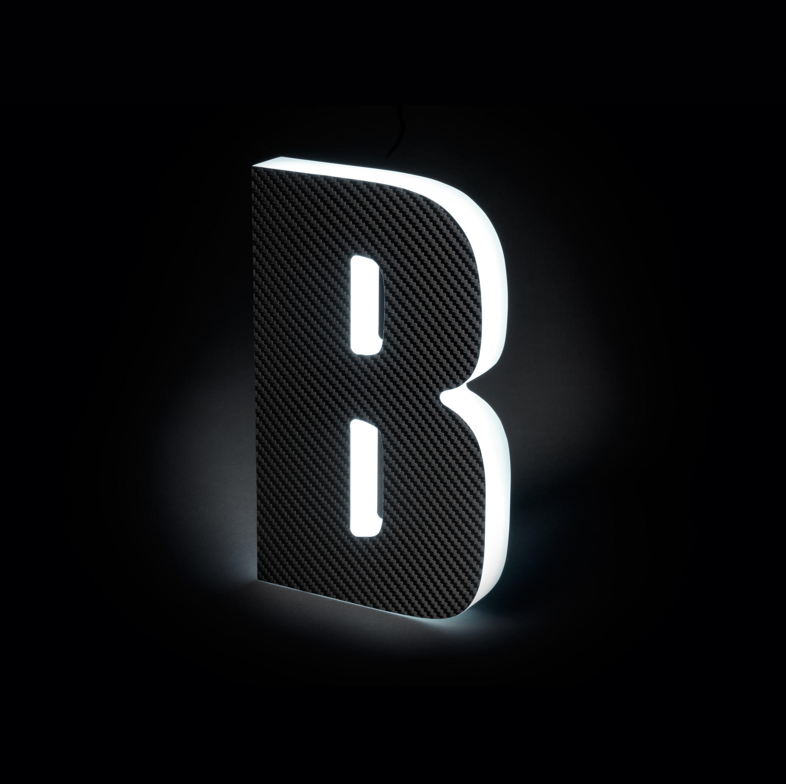 Sidelit Carbon Fiber Black Vinyl with Glowing Sides