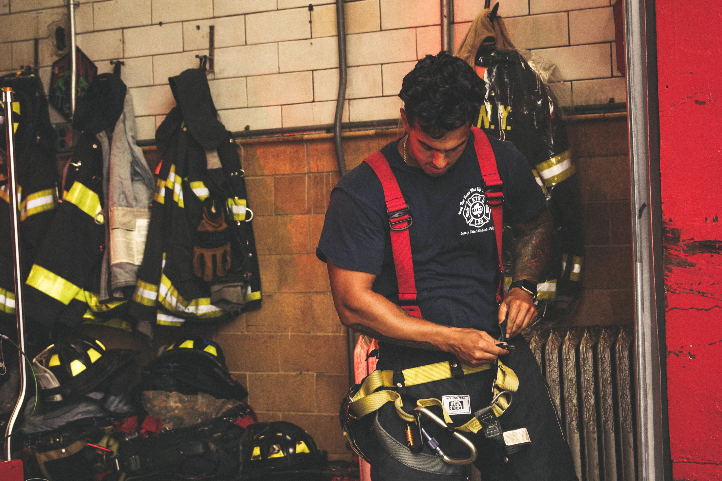 Fire fighter preparing for a call