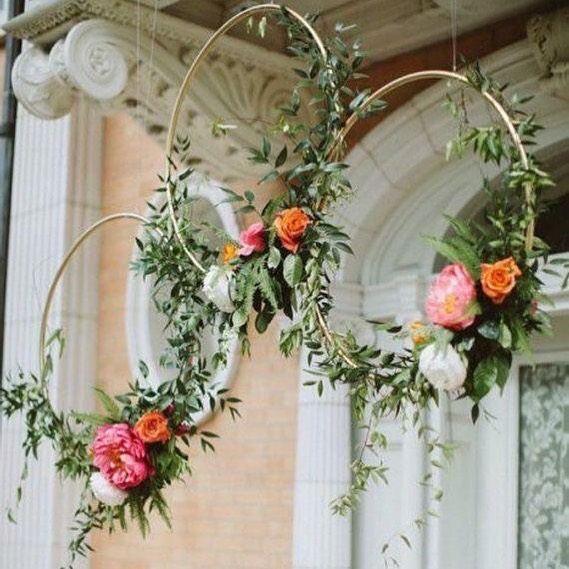 A creative way to have impact with fewer flowers. Hang at the entry of your event or above each table for some Wow! Wow!