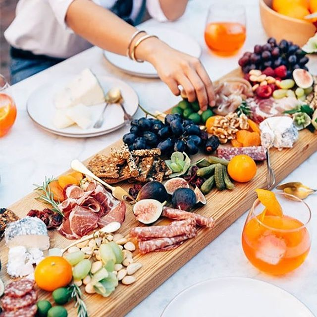 Use delicious food as your centerpiece! Perfect for a summer dinner party or outdoor event. Photo via The Zoe Report.