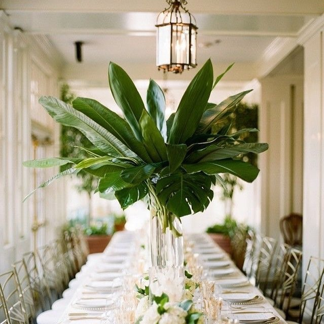 Simple and elegant tropical centerpiece. Photo via MyDomaine.com
