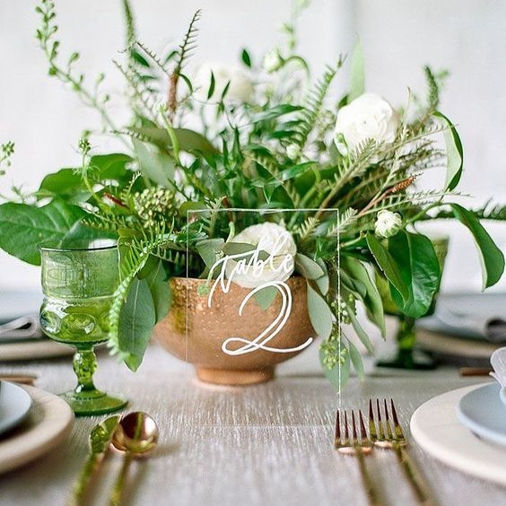 Green, white and copper with lucite table numbers. Very chic! Photo: Bride2Be