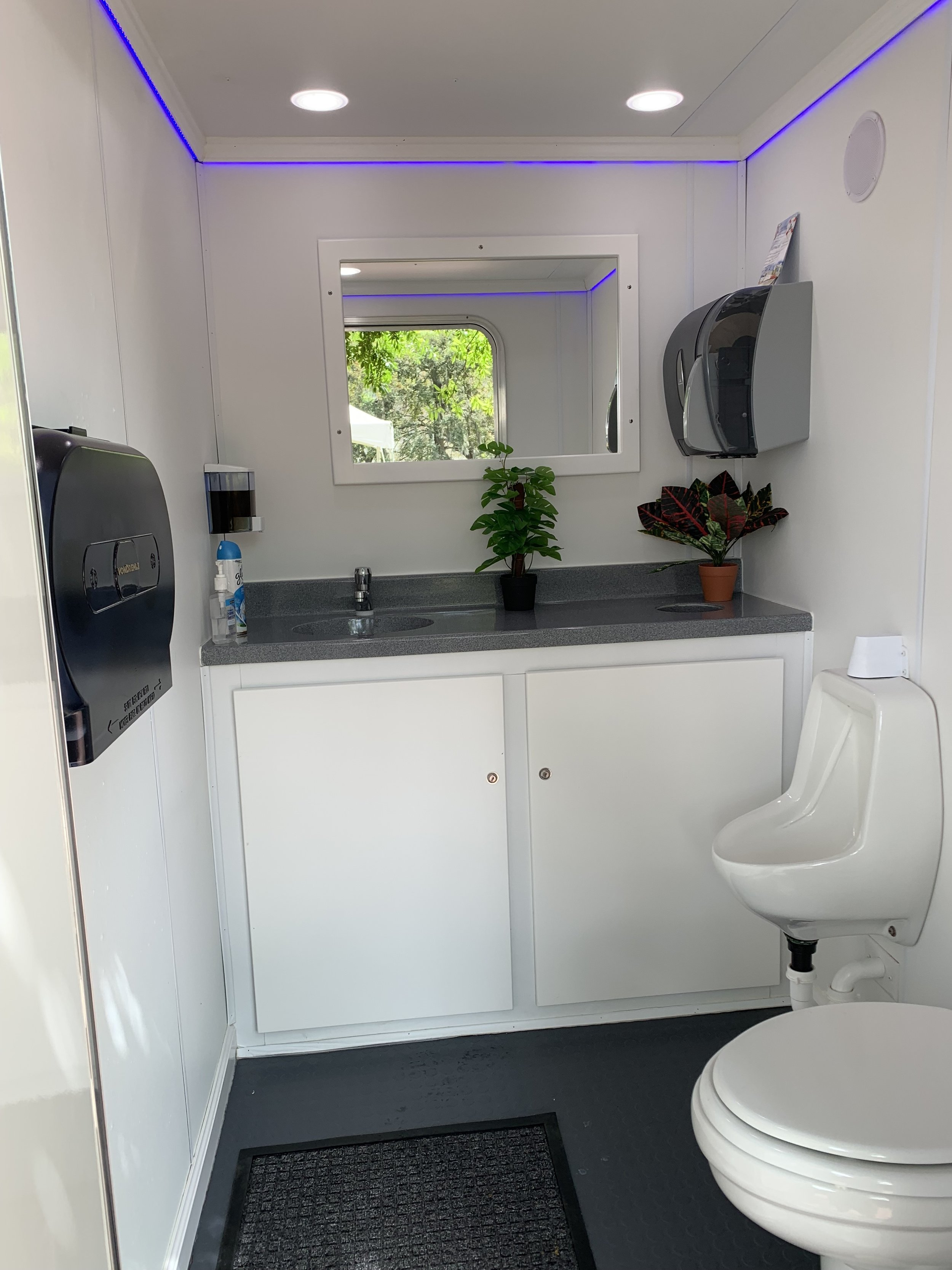 Our Restrooms - Our 16ft restroom trailers contain 3 separate restrooms (2 ladies room's and one men's room). Each is equipped with air conditioning, heat, radio, sink, soap dispenser, paper towels, trash receptacles, and porcelain toilet/urinal. These restrooms are well lit with LED lighting inside and out.
