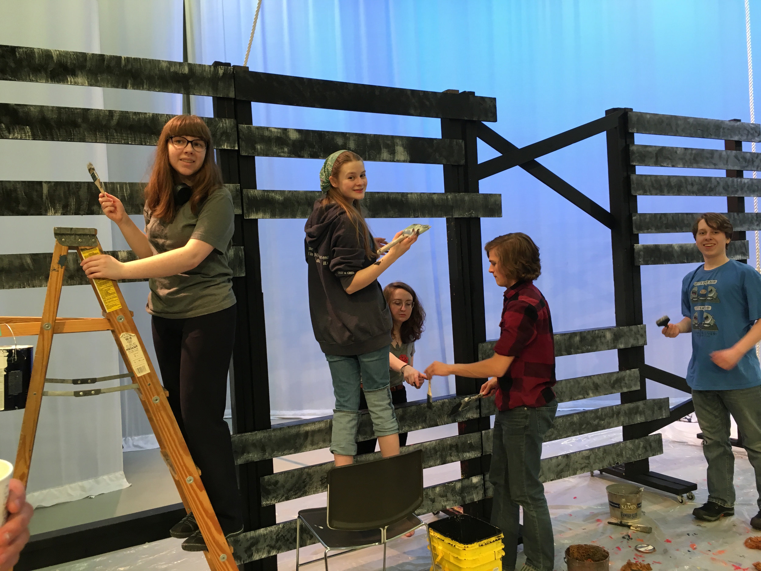 Students helping paint the set for SYT's 2019 production of THE TWO NOBLE KINSMEN
