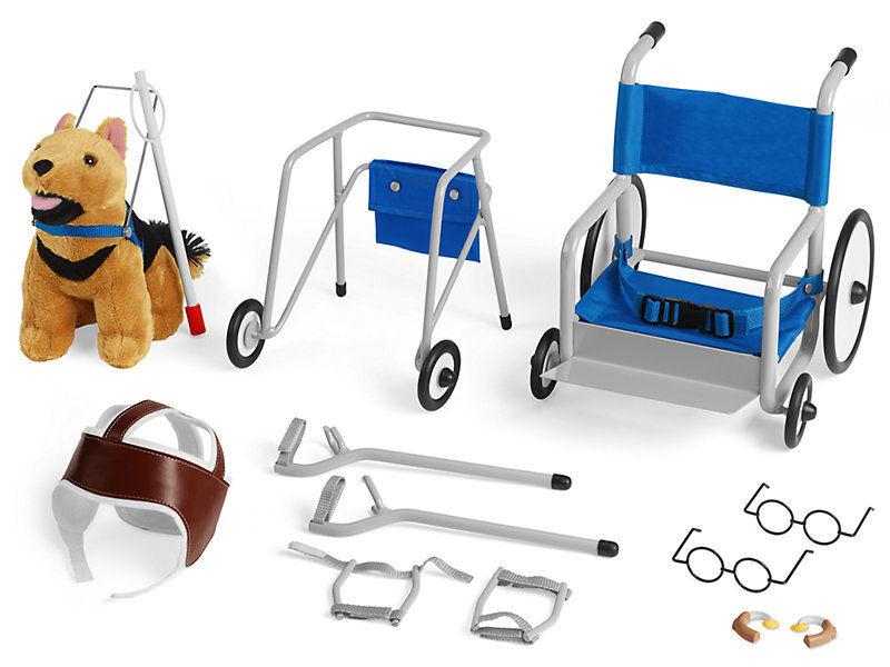 [Image Description: Toy adaptive equipment for dolls. From top left to bottom right: Service dog with harness, walker, wheelchair, protective helmet, arm crutches, round wire-rimmed glasses, and hearing aids.]