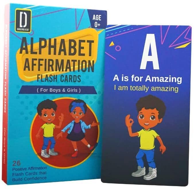 """[Image Description: A box that reads """"Alphabet Affirmation Flash Cards (For Boys & Girls) 0+ 26 Positive Affirmation Flash Cards That Build Confidence"""". The box features a boy and girl with brown skin smiling. Beside the box is a card that reads """"A is for Amazing. I am totally amazing."""" The card features the same boy form the cover of the box smiling.""""]"""
