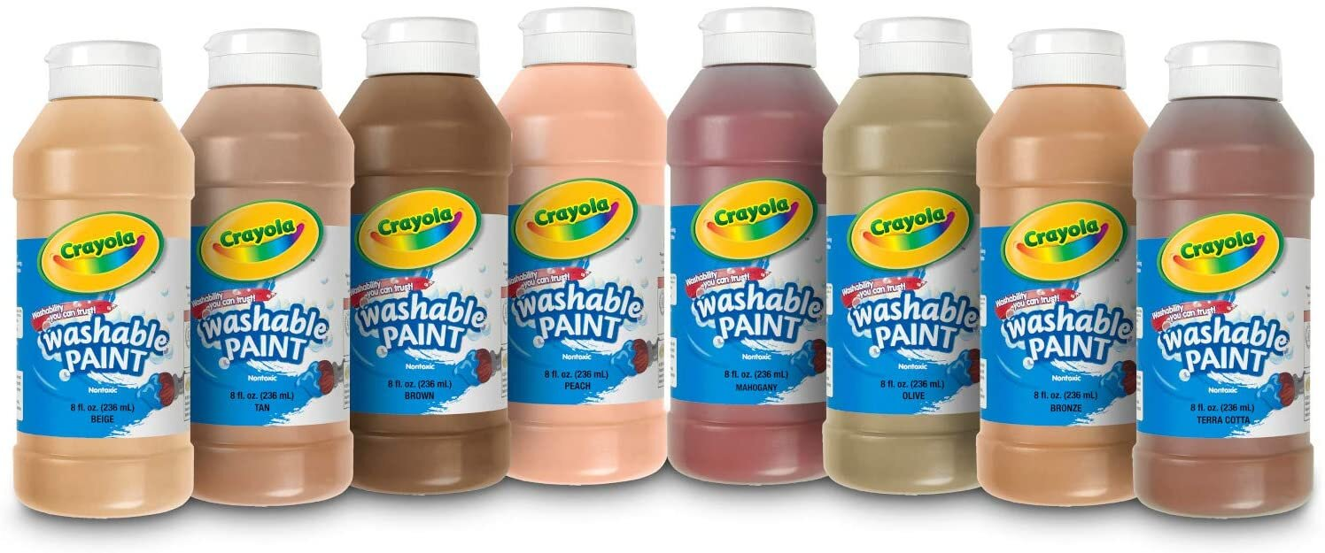"""[Image Description: Eight bottles of paint in various skin tone colors. Blue and white labels on each bottle read """"Crayola Washable Paint"""".]"""