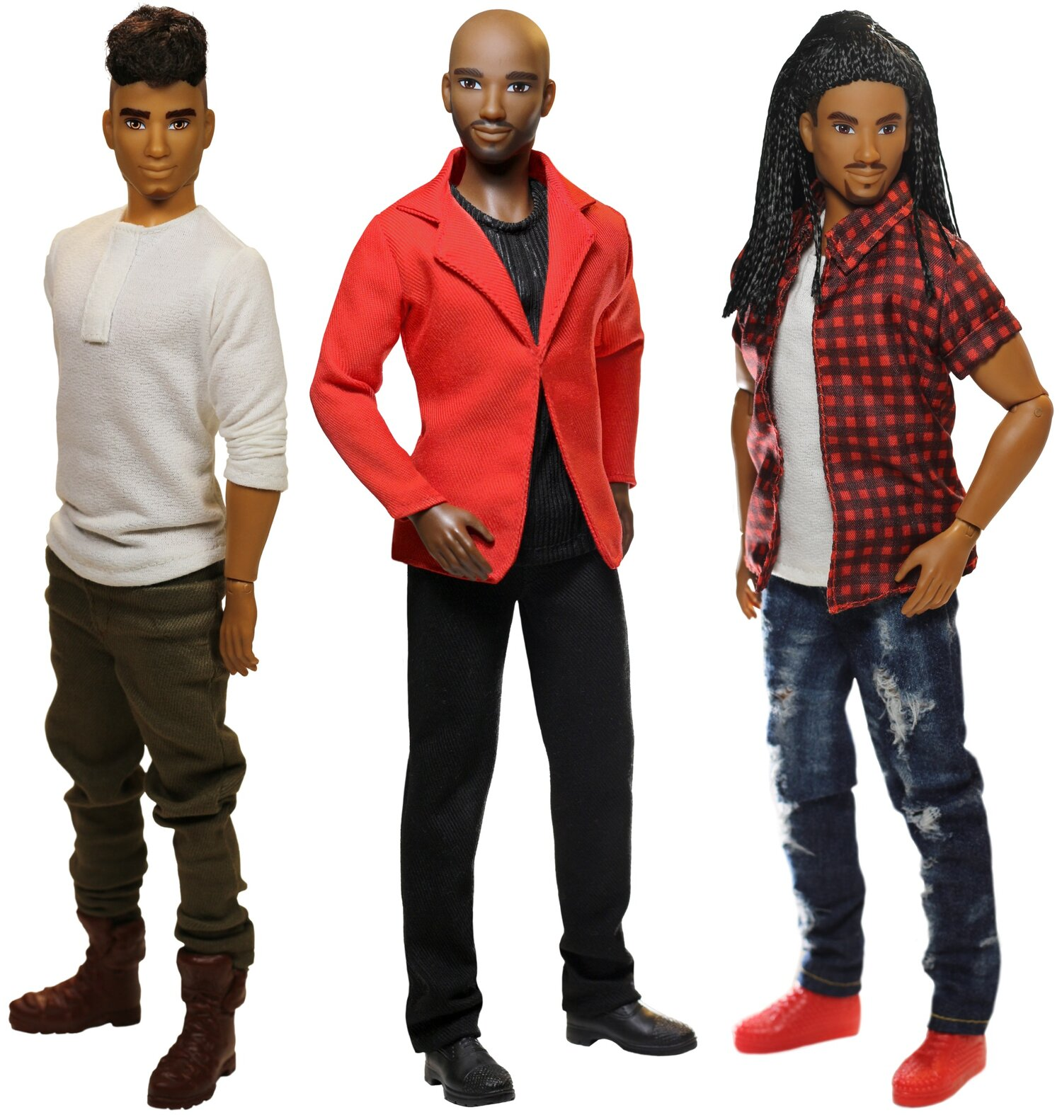 """Three male-coded dolls. The doll to the left has caramel skin, curly brown hair in an undercut, and a goatee. They are wearing a white shirt with olive colored pants and brown boots. The middle doll has dark brown skin, a neatly-trimmed beard and is bald. They are wearing a black shirt, red blazer, black pants, and black loafers. The doll to the far right has light brown skin, a trimmed moustache and beard, and their black hair is pulled back into long braids. They are wearing white t-shirt with a red short sleeved plaid shirt over it as well as blue jeans and red sneakers"""".]"""