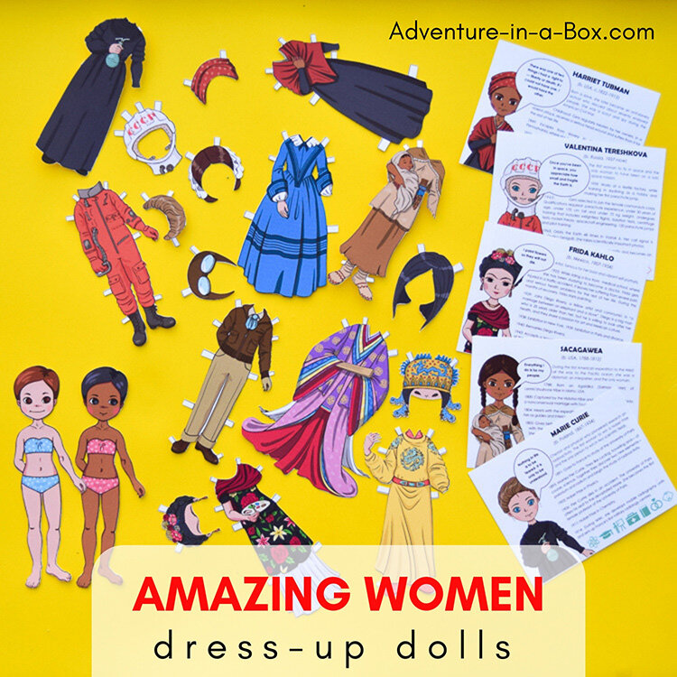 """[Image Description: Two female-coded paper dolls, one with light skin and one with brown skin. There are also various dress up outfits for the dolls and cards explaining who the women were. The cards displayed include Harriet Tubman, Valentina Tereshkova, Frida Kahlo, Sacagawea, and Marie Curie. The image reads """"Amazing Women Dress-up Dolls"""".]"""