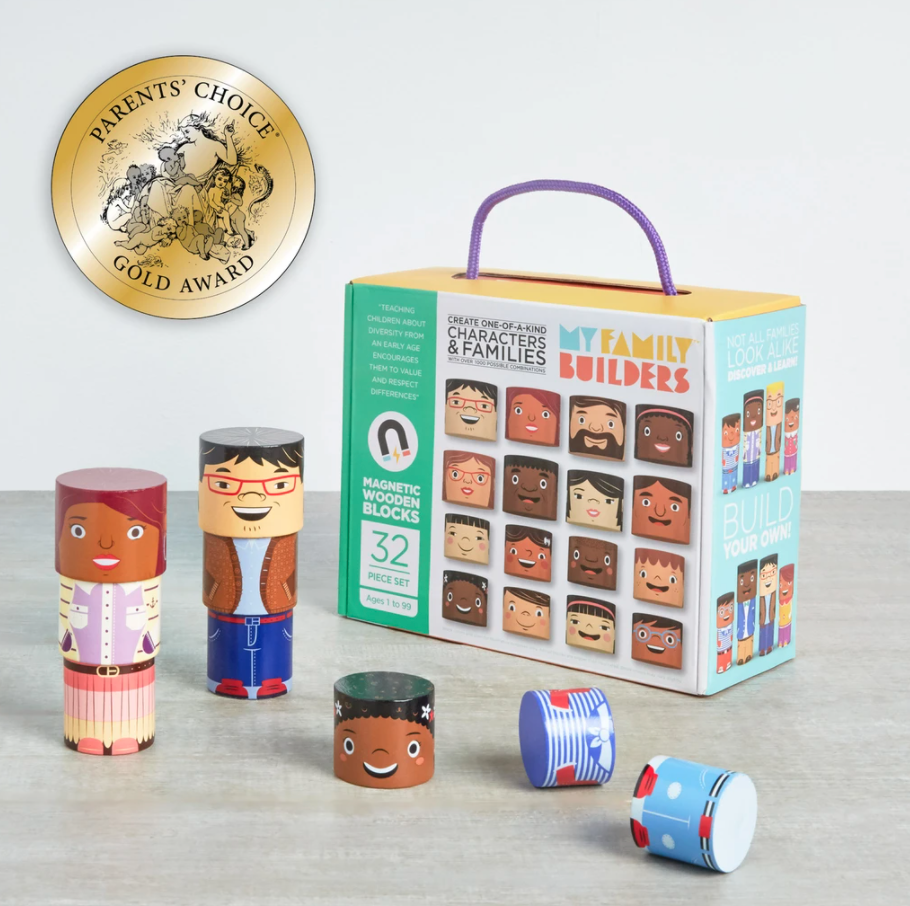 """[Image Description: A box that reads """"My Family Builders Create One-of-a-Kind Characters and Families 32 Piece set"""" The box features cylindrical blocks with various faces, skin tones, and hair colors. In front of the box are two figures build of three blocks each, one head, one torso, and one bottom. There is also a head, torso, and bottom that have seemingly fallen over. In the top right corner there is a golden seal that reads """"Parent's Choice Gold Award""""]"""