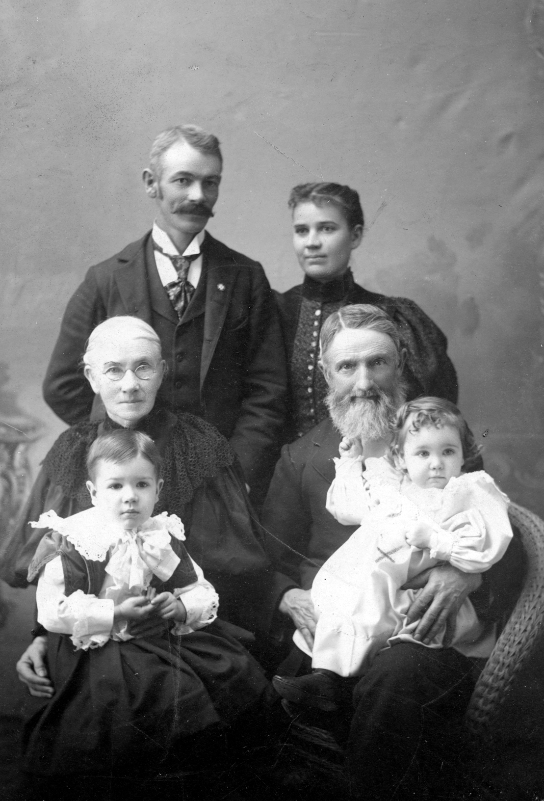 Carl S and Betah English, standing behind Carl's parents, Persis and Jude.  Seated in laps, Roy and