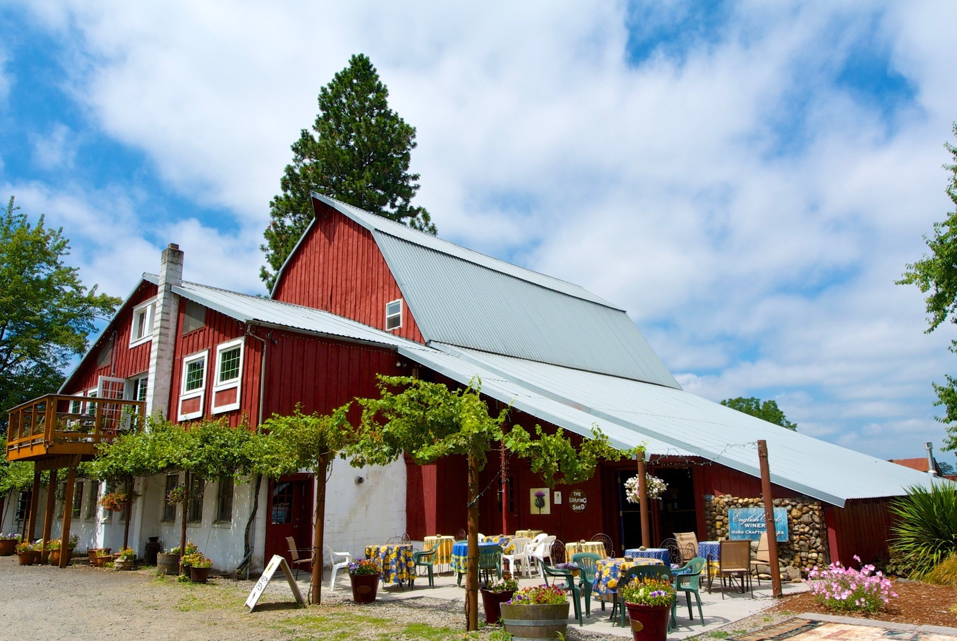 The Loafing Shed Tasting Room is located in our 1915 barn surrounded by 20 acres of vineyards and gardens.
