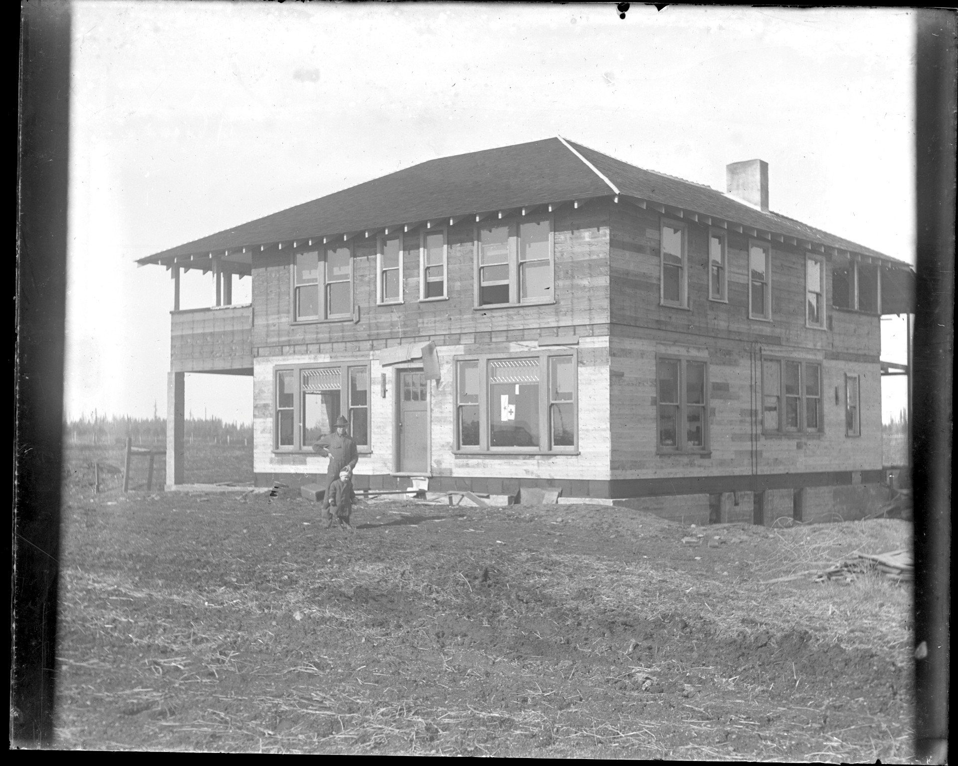 Farmhouse under construction, 1916.
