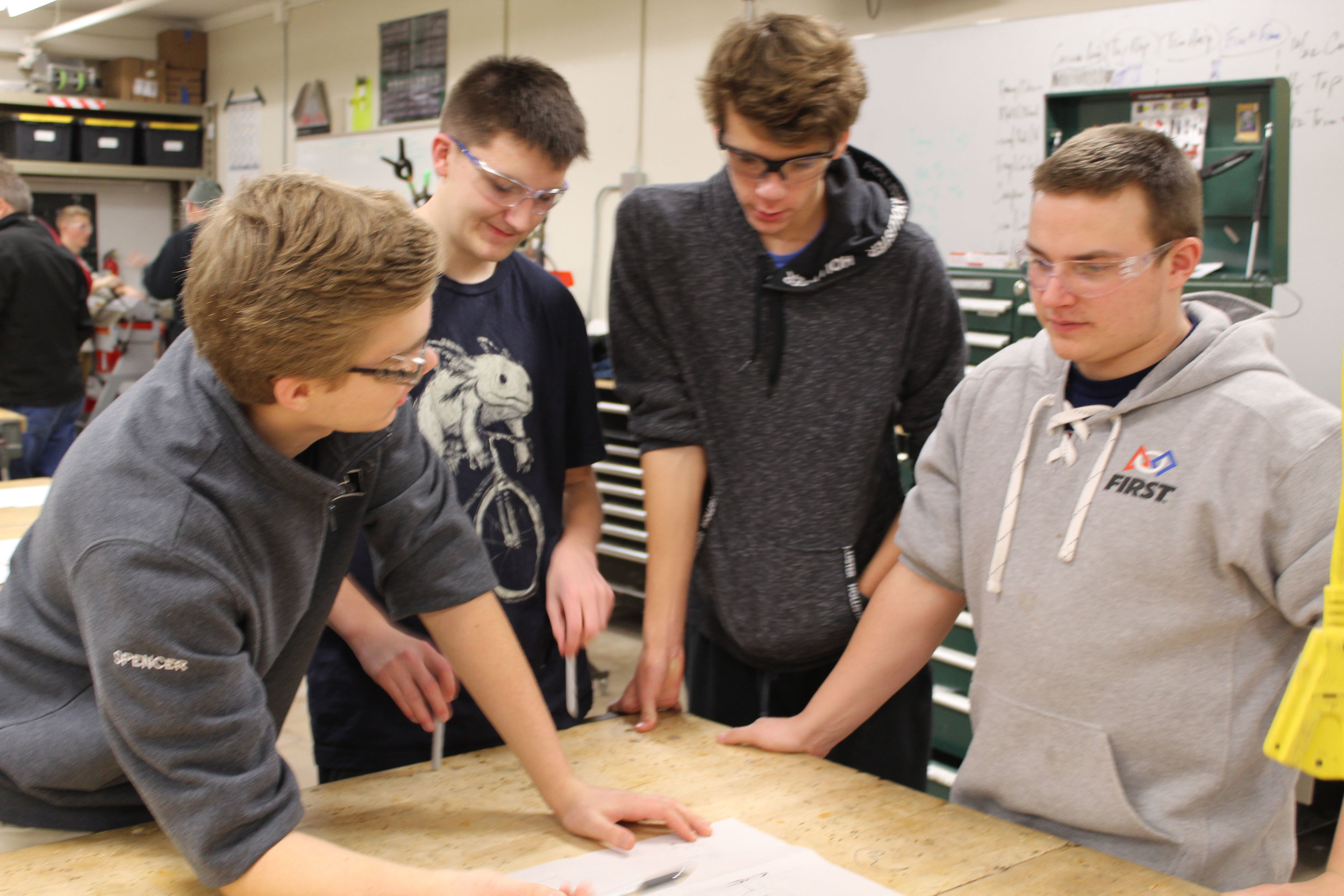 Spencer, Simon, Elliot, and Kale discussing designs and what to do next!