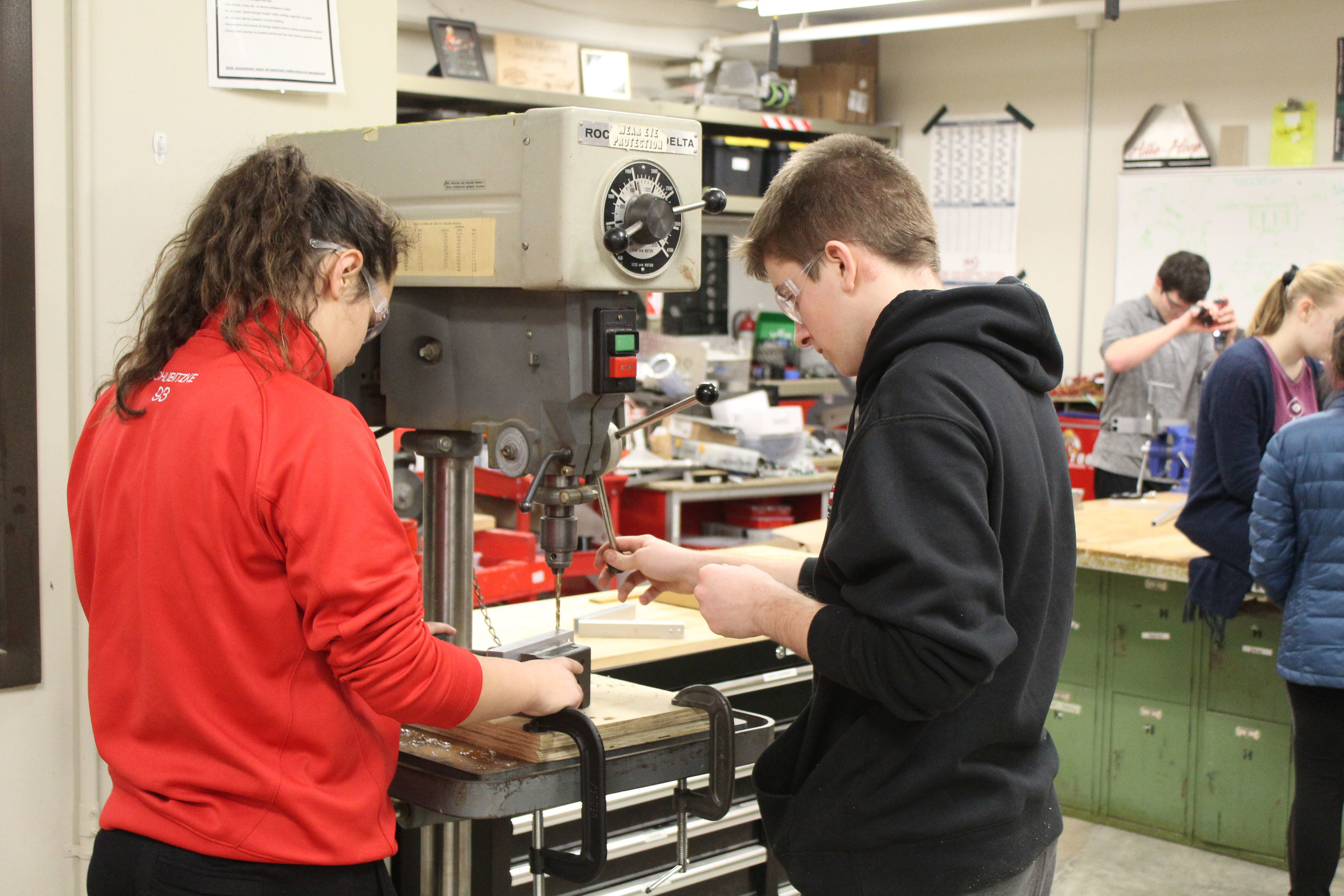 Kylene and Daniel from Build drilling pieces