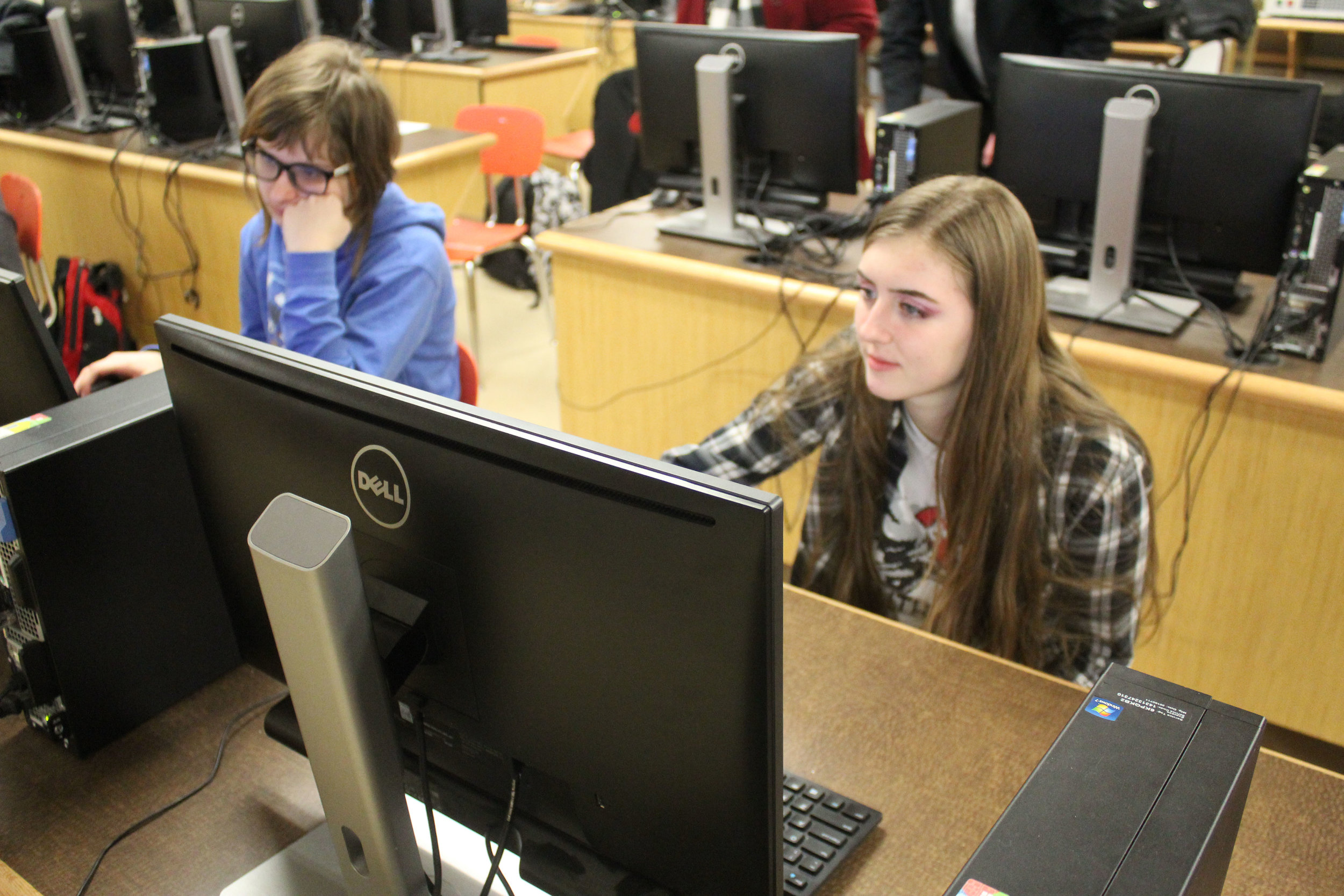 Kya and Harley working hard to finish up the FRC Journal and scheduling.