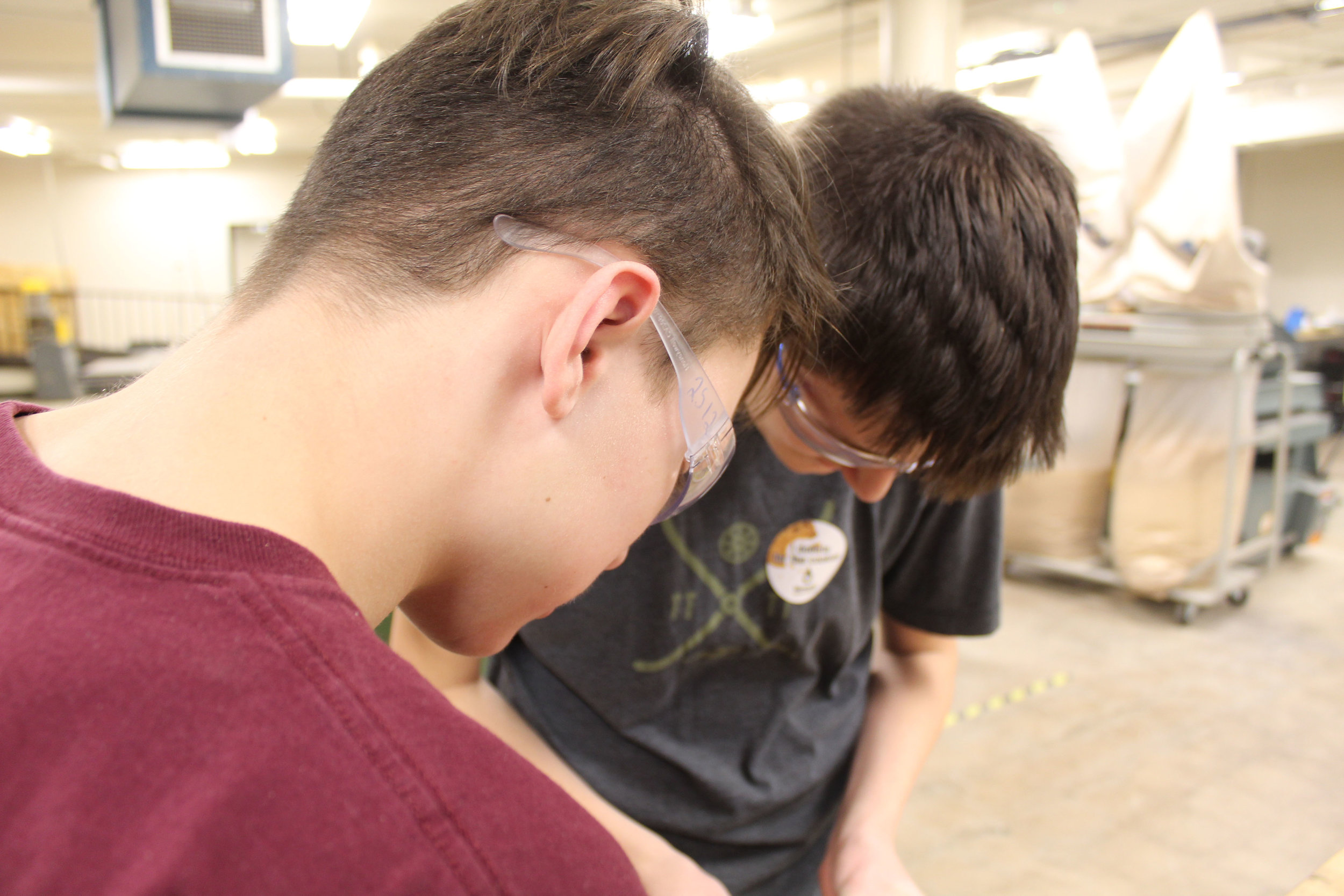 Elliot and Graham of the Electronics Department building parts of the robot