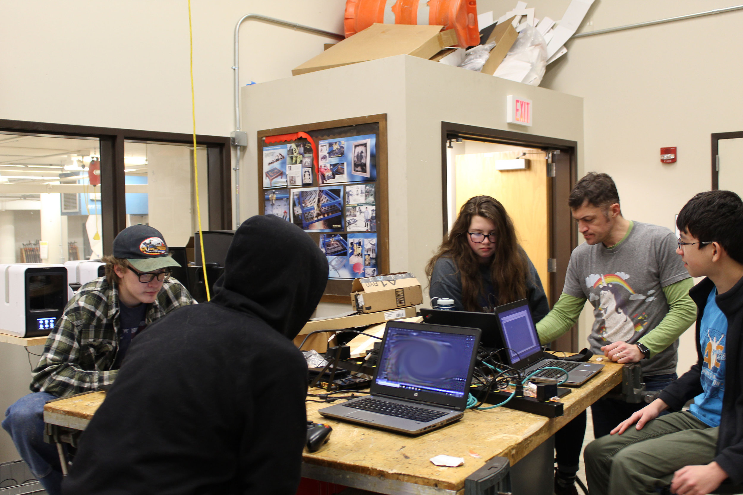 Programming Department, Jared, Tobi, Harper, and Ike working together to code the robot.