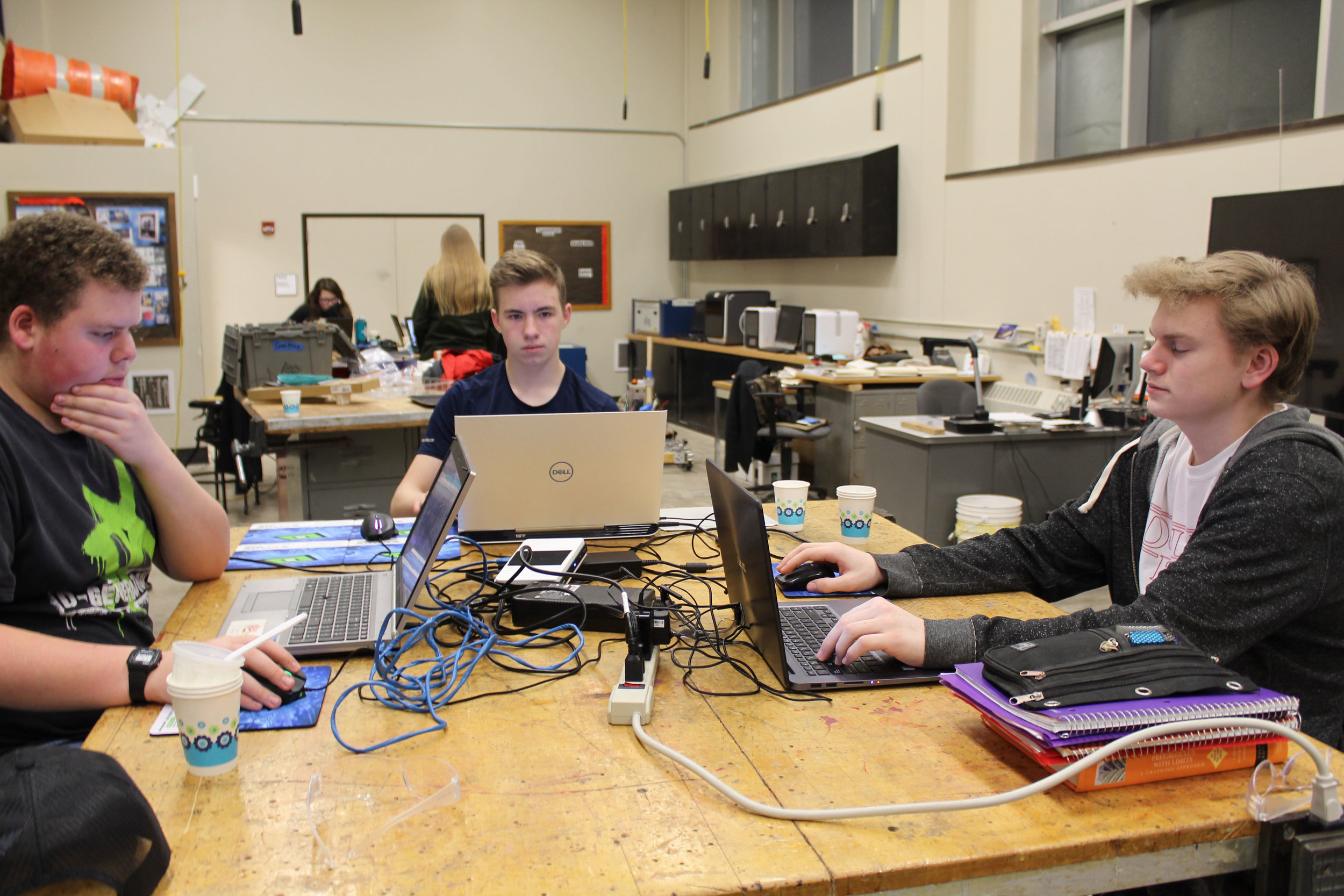 CAD Department, Jacob, Sean, and Anders designing parts for the bot.