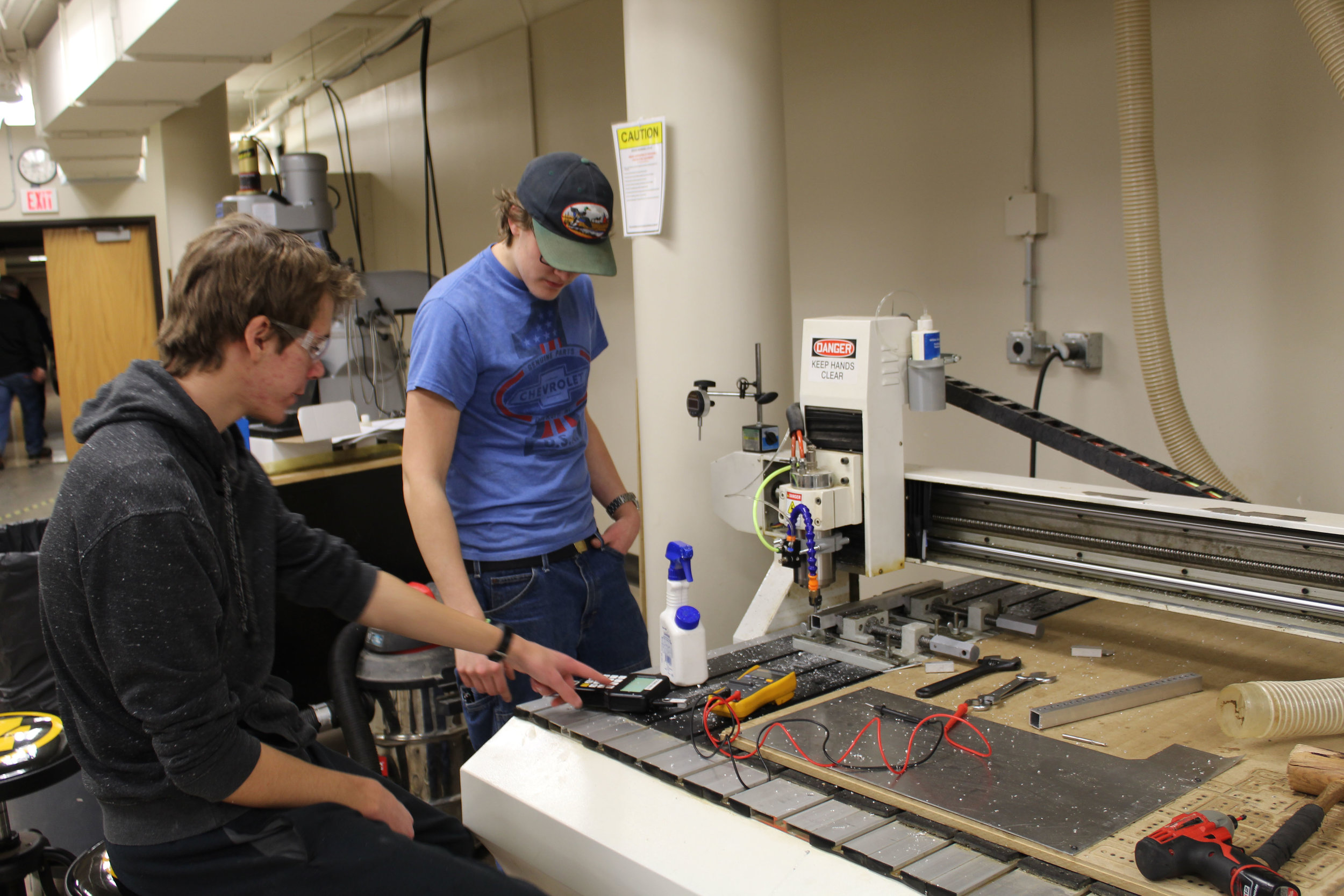 Simon and Jared cutting parts for the robot