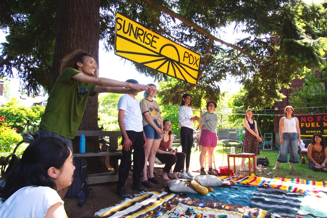 Sunrise Movement PDX's June hub meeting kicking off with a game of Wa!