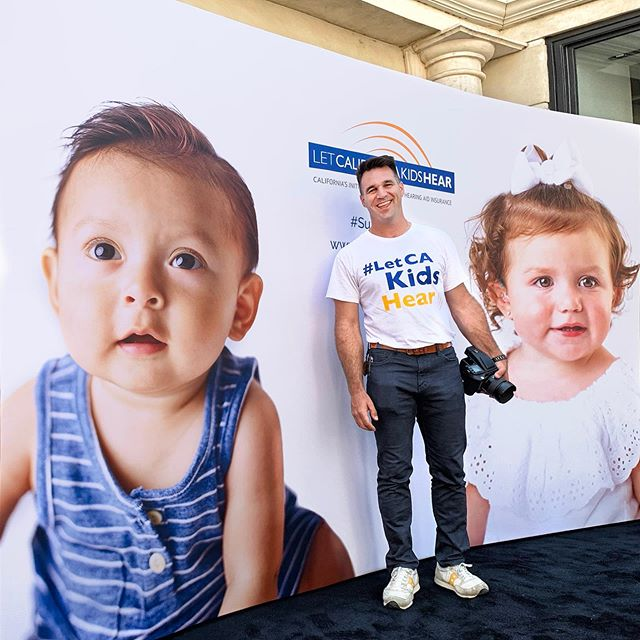 """Me at @thegrovela supporting @letcakidshear_ab598 w/ @idinamenzel @rickcaruso and my wife @rockman_productions  #letcakidshear #SupportAB598  I'm thrilled to be supporting this coalition with my portraits of these amazing children! And starting tomorrow getting to see them larger than life at @thegrovela and @americanabrand !  Thank you @rockman_productions for getting us involved and for doing all the production on both shoots!! Let's all help by supporting! #SupportAB598 for more info go to letcakidshear.com  Special thanks to following people who worked really hard to make both shoots a reality:  Production by @rockman_productions  Hair & Makeup day 1 by @nattiventi w/ @opusbeauty  Hair & Makeup day 2 by @olga_pirmatova w/ @loweandcoworldwide  I couldn't do anything without @jaycfoster Thank you, Jay!  If you're still reading, did you know children's hearing aids are NOT covered by insurance if you live in the progressive state of CA?! We are trying to help get this bill passed to change this. A child's hearing aids cost as much as $6,000 per pair and the insurance companies call it an """"elective"""" or """"pre-existing condition"""" and don't cover! Hearing aids make SUCH a huge difference in a child's learning and development if needed, like our son Julian. Michelle Marciniak came to us with her and her partner Lydia's project and Sam and I both jumped at the chance to help out. Some kids go without and it pains us to think this could and should change. #letcakidshear"""