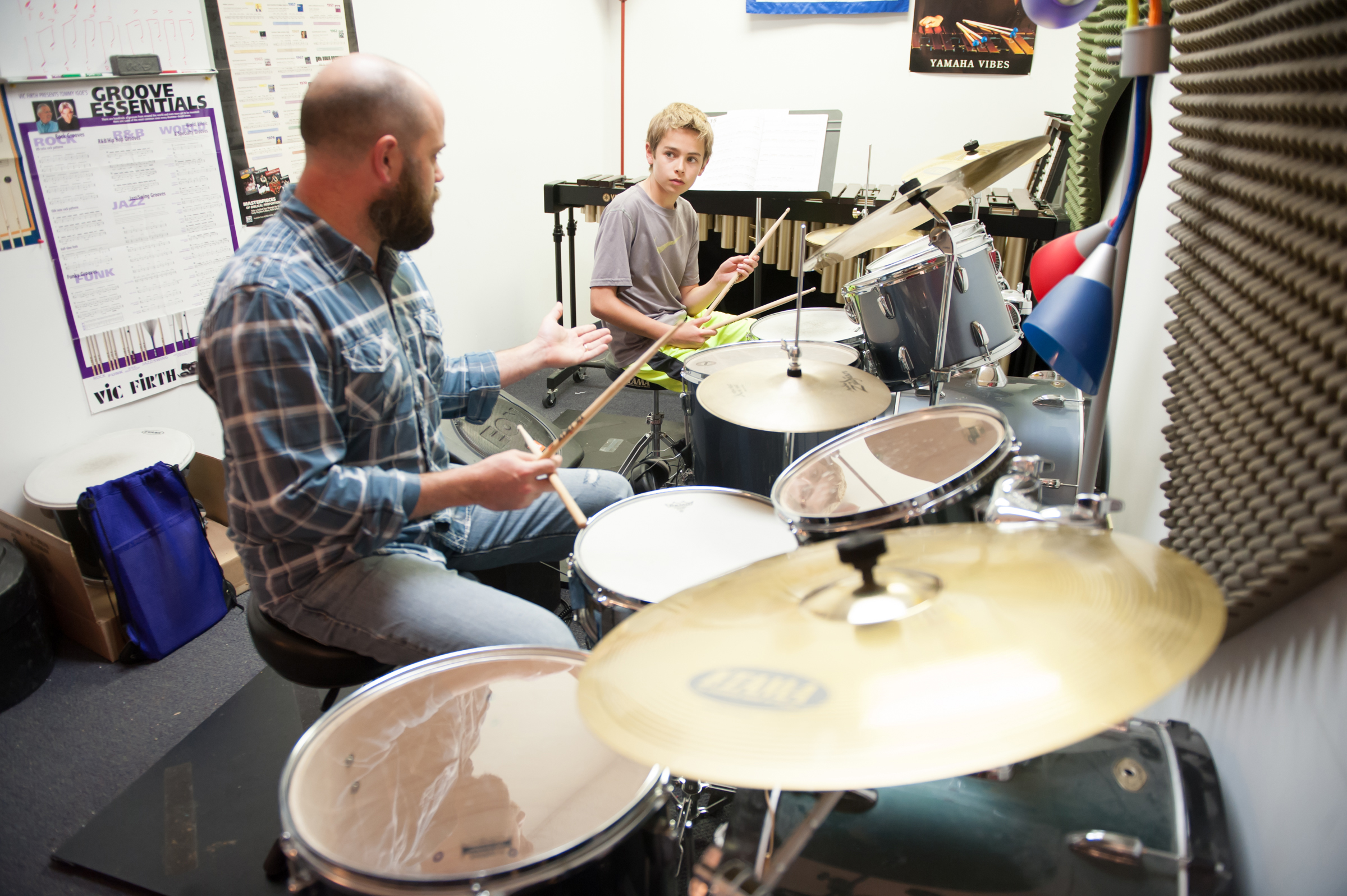 Brandon teaching drums.jpg