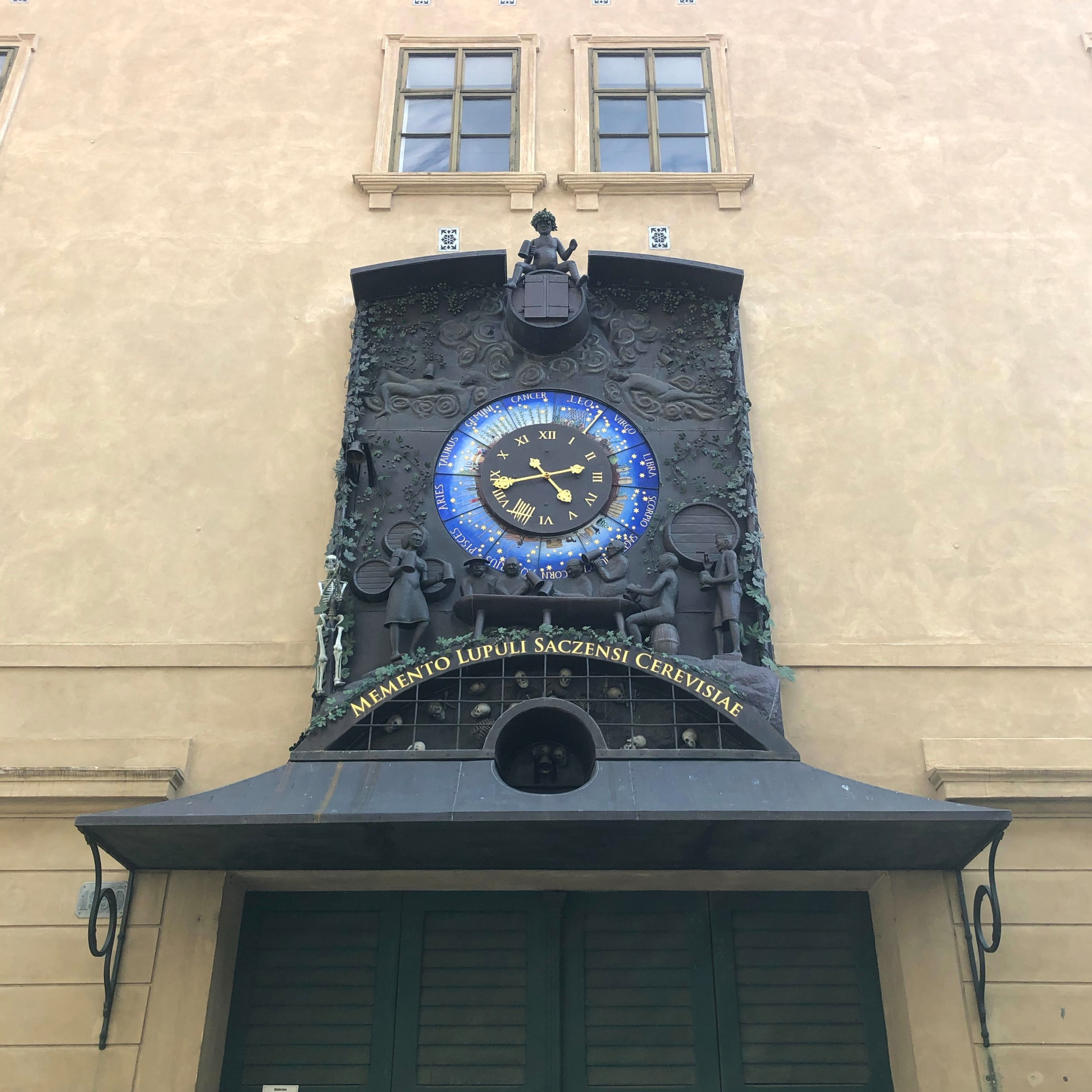 The small astronomical clock in Žatec, which shows each astrological sign as a season and illustrates what must be done with the hops within that season. The small skeleton pulls the string on the bell that chimes at each hour.
