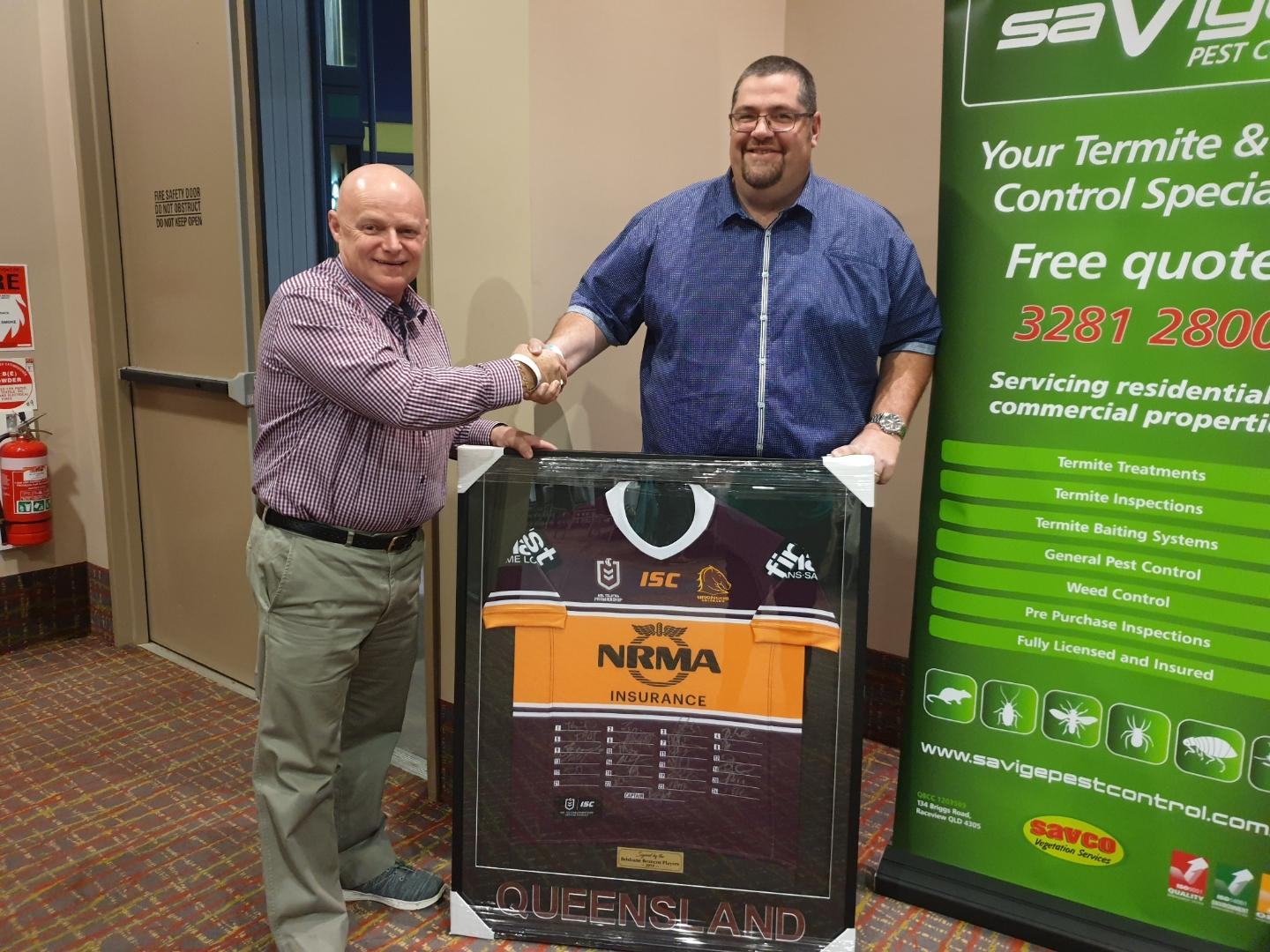 Signed, sealed, delivered :  Steve Rainbow from Articulate Framing Ipswich presents  a signed Brisbane Broncos Jersey to Swich On Inc life member Grant Lowe to help fundraise at our next event.