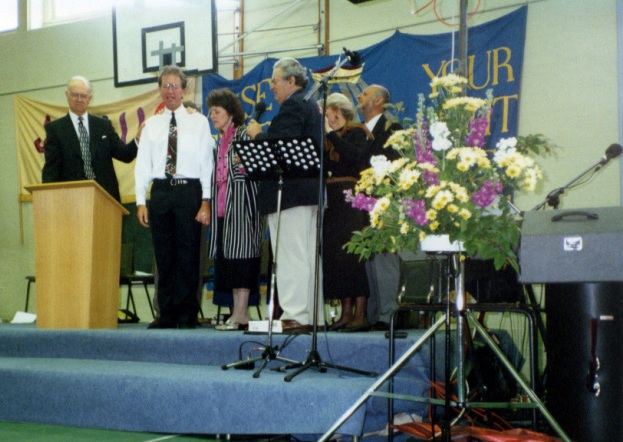 "1996 - Dave released local hand-on responsibility to fulfil wider responsibilities in the body of Christ. He maintained Basingstoke as his base and gave input to the Church, but the senior pastor's role was taken by David Marchment alongside his wife Hazel. Under Dave's leadership the emphasis on local outreach grew. In this period was the participation of the church in what became known as 'the Toronto blessing.' Also of note were the growing relationship of deep trust between ministers in the town, and the formation of the interdenominational ""Network Ministers"" of which the Community Church was an active part.Sadly in 1997 Dave was diagnosed with leukaemia. Although he experienced times of remission Dave died from this in 2002. During Dave's illness Andy Taylor, and Dave Downer, two congregation leaders, held the Church on course."