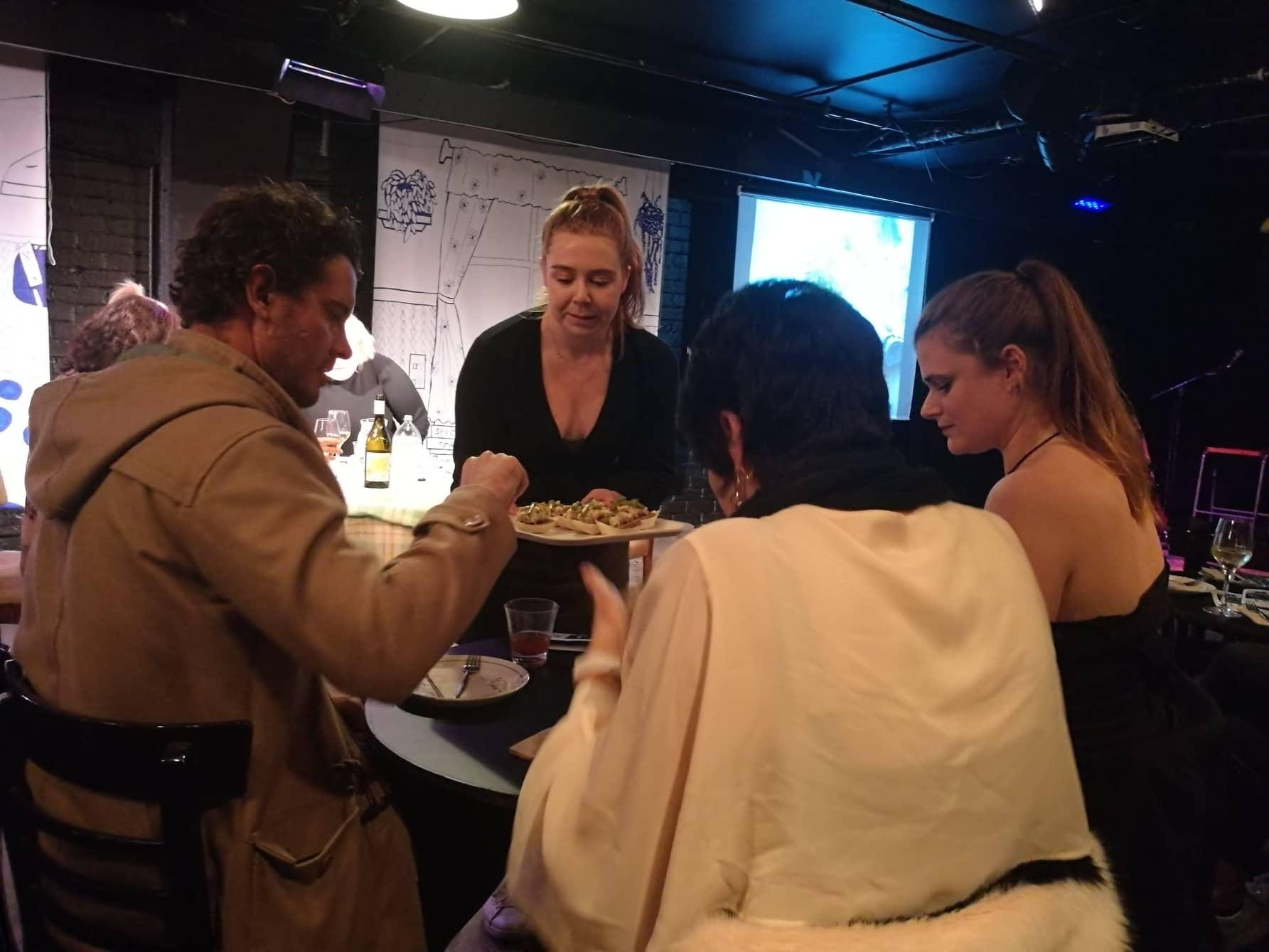 Thursday 13 - Erin's family try some food.jpg