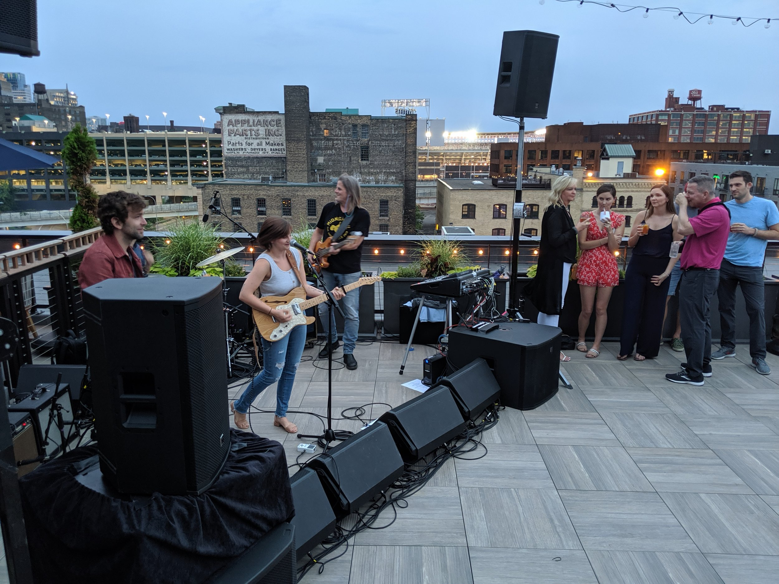Paul and Faith in concert on the rooftop of  The Hewing Hotel.