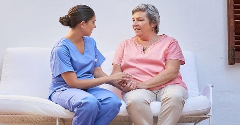 Nurse-listening-to-patient-iStock-682596010.jpg