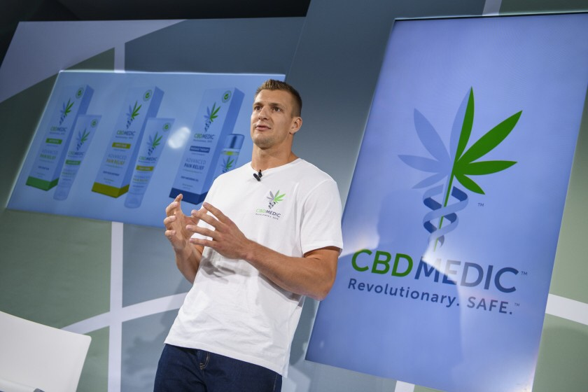 Former New England Patriots tight end Rob Gronkowski holds a news conference in August announcing his advocacy for cannabidol (CBD) and his decision to partner with a company selling CBD products.    (Associated Press)