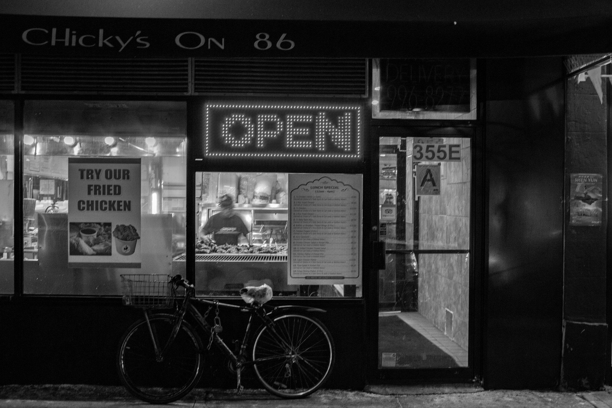 2 of 6:  Storefront street scene, Upper East Side, New York, NY.