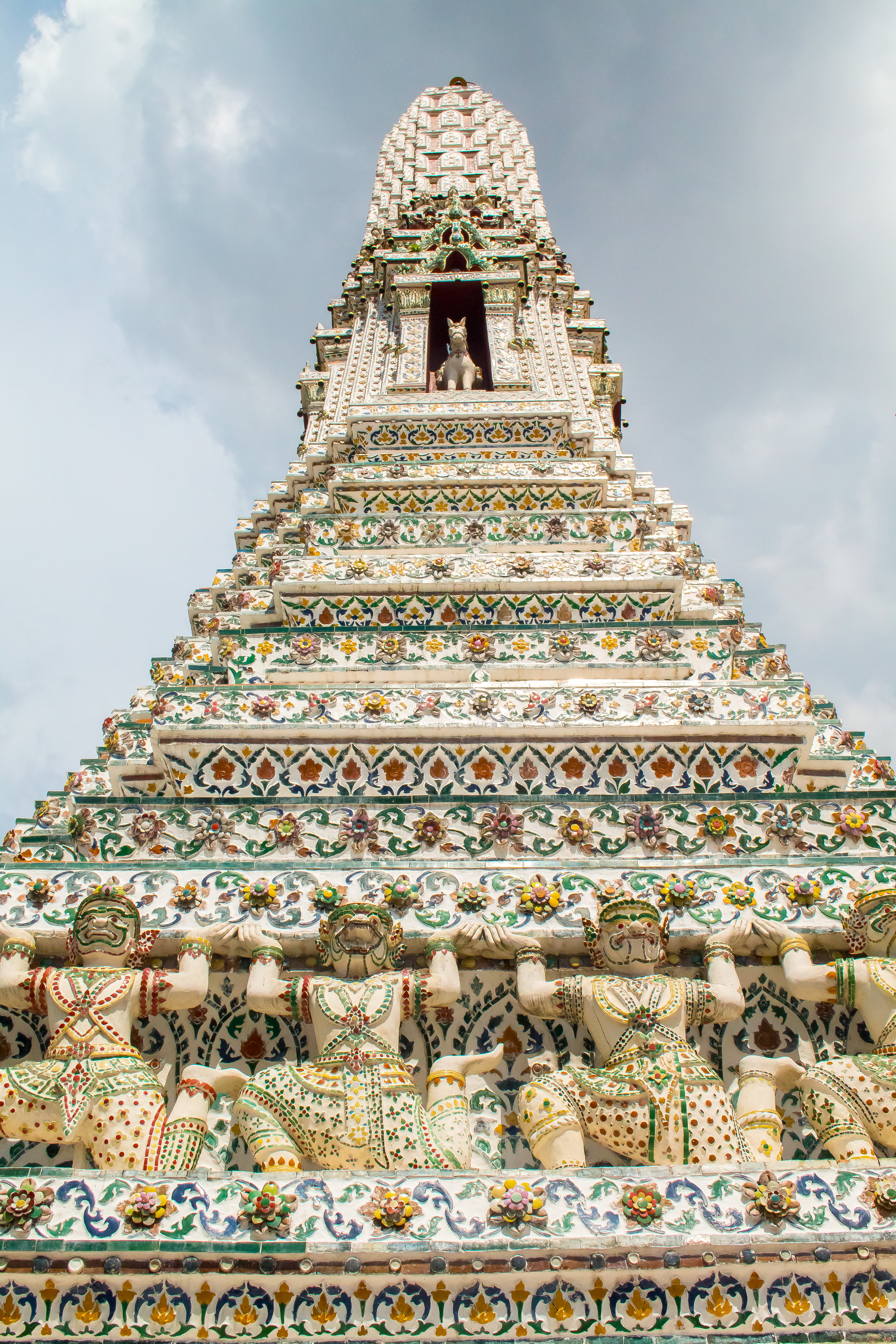Detail of one of the spires of Wat Arun, Bangkok, Thailand